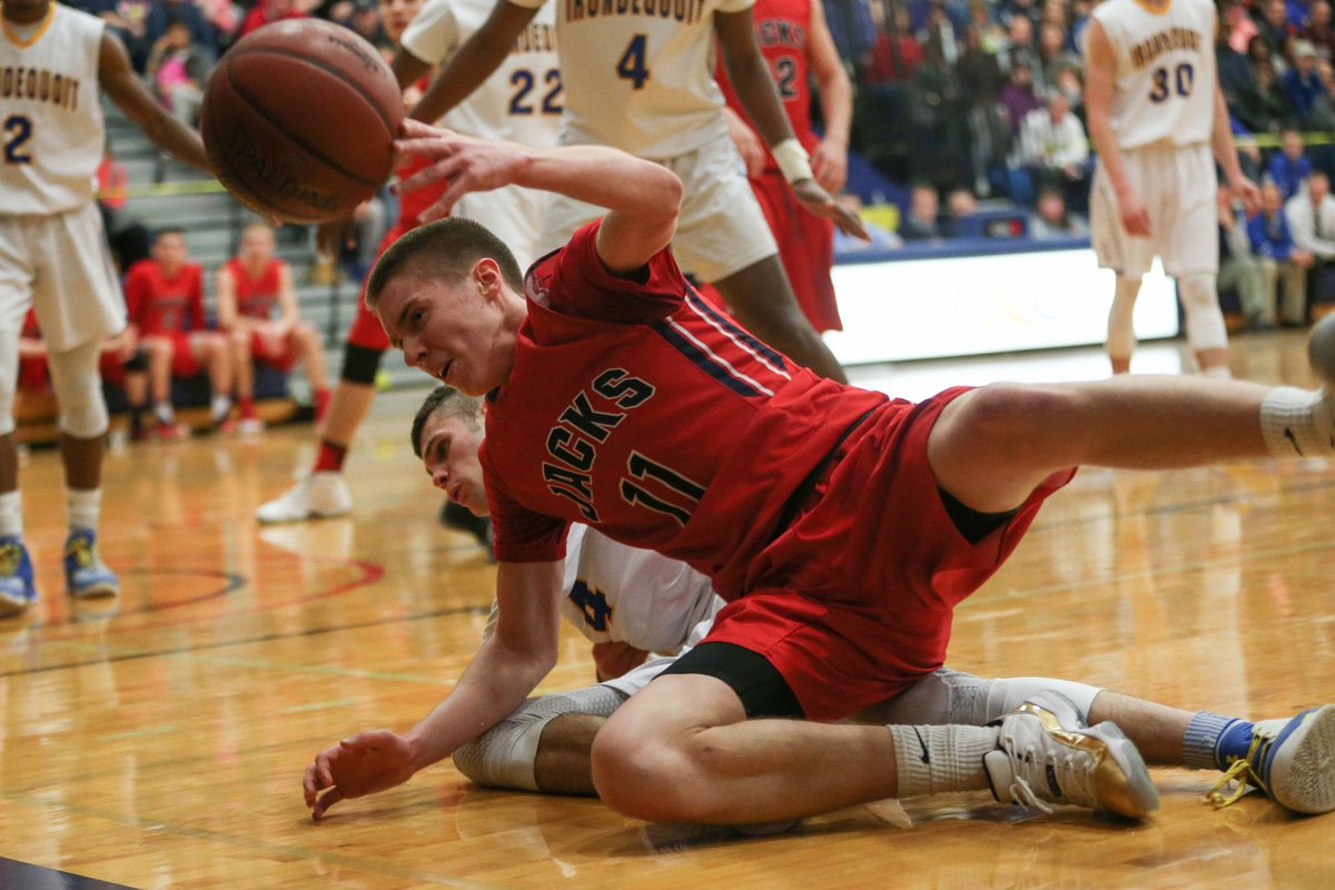 North Tonawanda's Trevorr Book hits the deck during the Lumberjacks' loss to Irondequoit in the Far West Regional Class A game at Genesee Community College. (Derek Gee/Buffalo News)