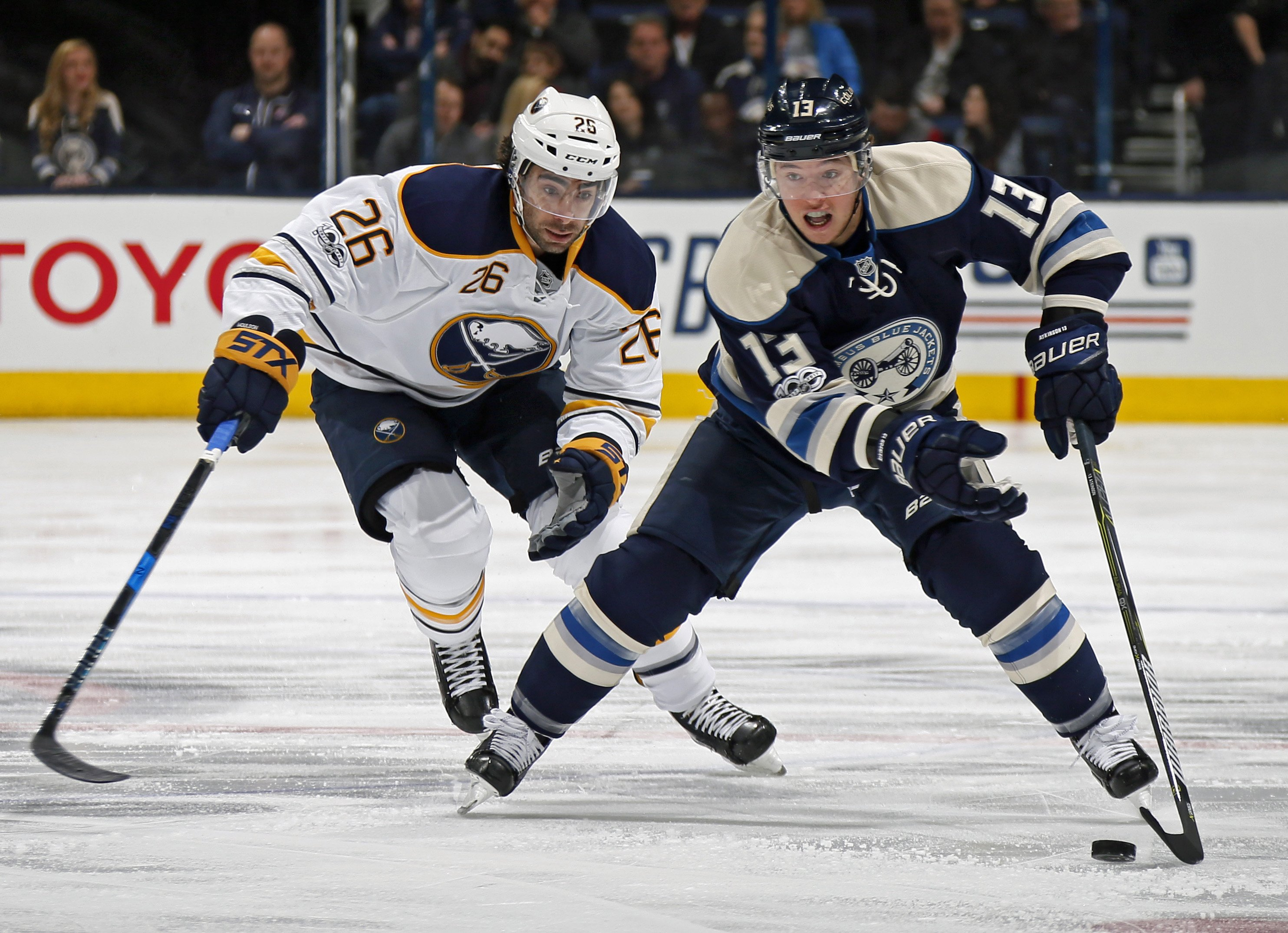 The Sabres' Matt Moulson chases Columbus' Cam Atkinson on Tuesday. (Tribune News Service)