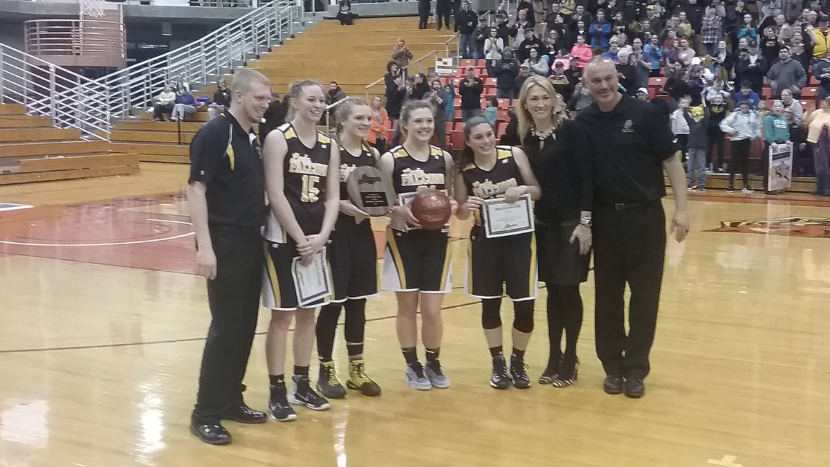South Seneca's players and coaches collect a trophy at the Far West Regionals.