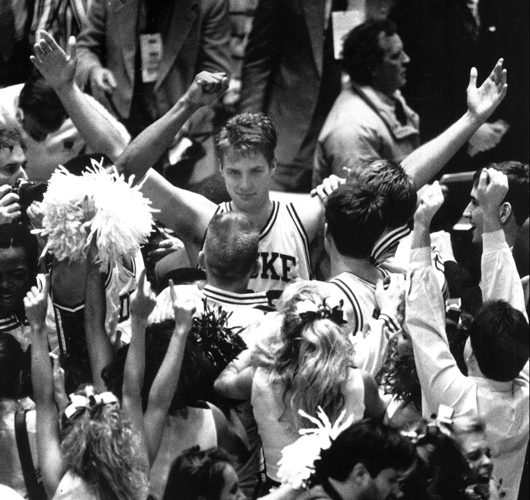 Duke's Christian Laettner celebrates his game-winning basket against Kentucky in 1992's Eastern Regional Final. (Photo by Charles Fox, courtesy of the Philadelphia Inquirer)