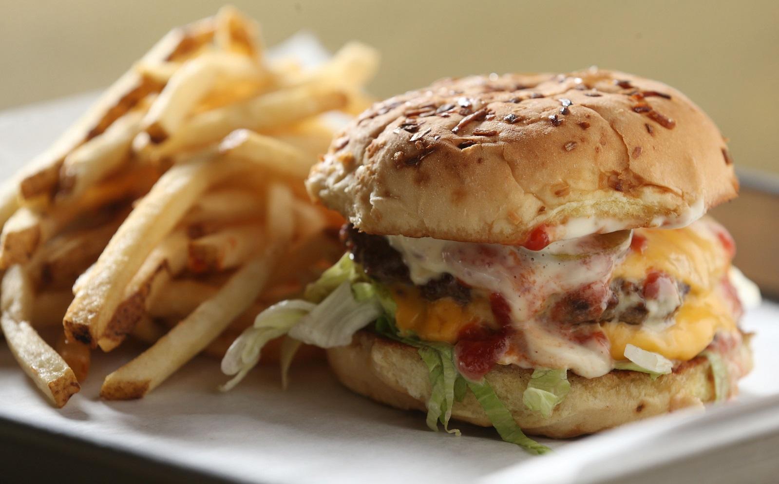Thin Man burger with two natural beef patties, pickles, lettuce, house mayo, ketchup and American cheese. (Sharon Cantillon/Buffalo News)