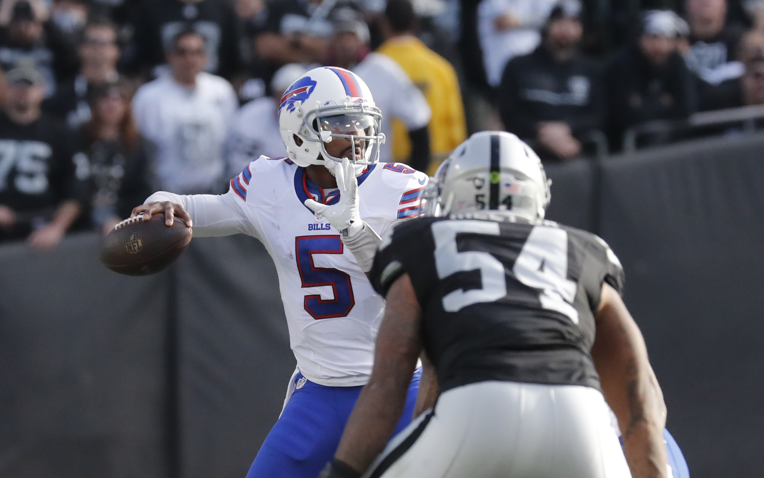 Buffalo Bills quarterback Tyrod Taylor, shown against the Oakland Raiders, is coming back. (Harry Scull Jr./Buffalo News)