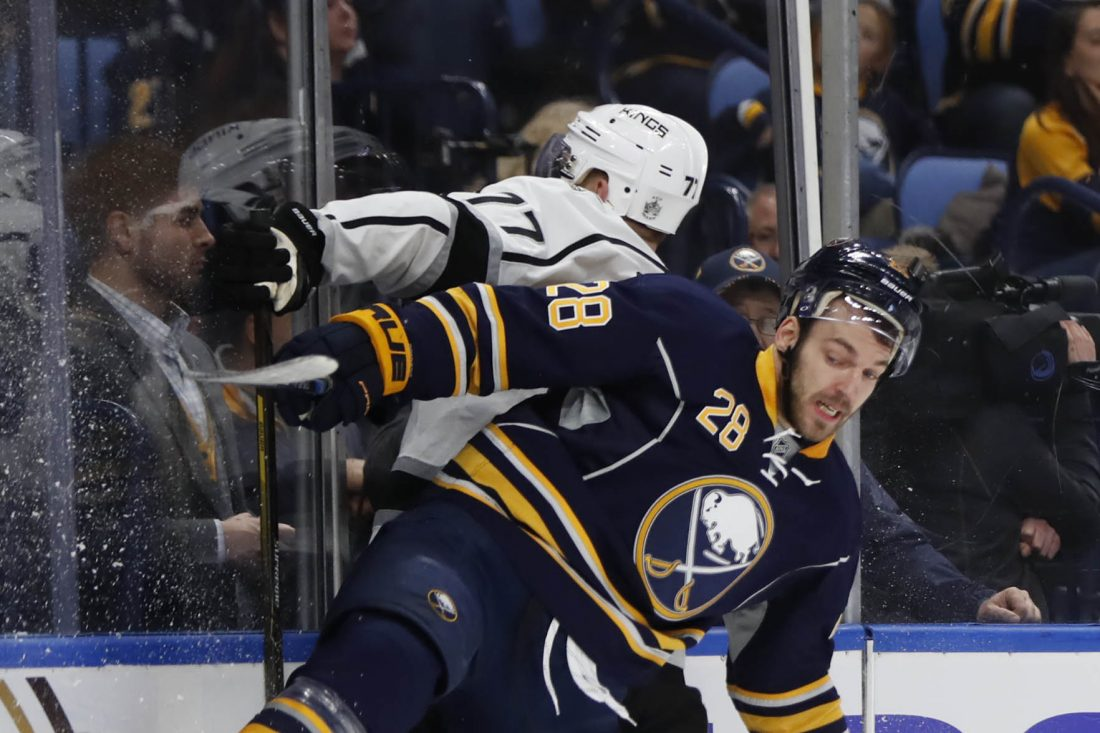Zemgus Girgensons battles Jeff Carter during the Sabres' 6-3 win over Los Angeles Dec. 13 in KeyBank Center (Harry Scull Jr./Buffalo News).