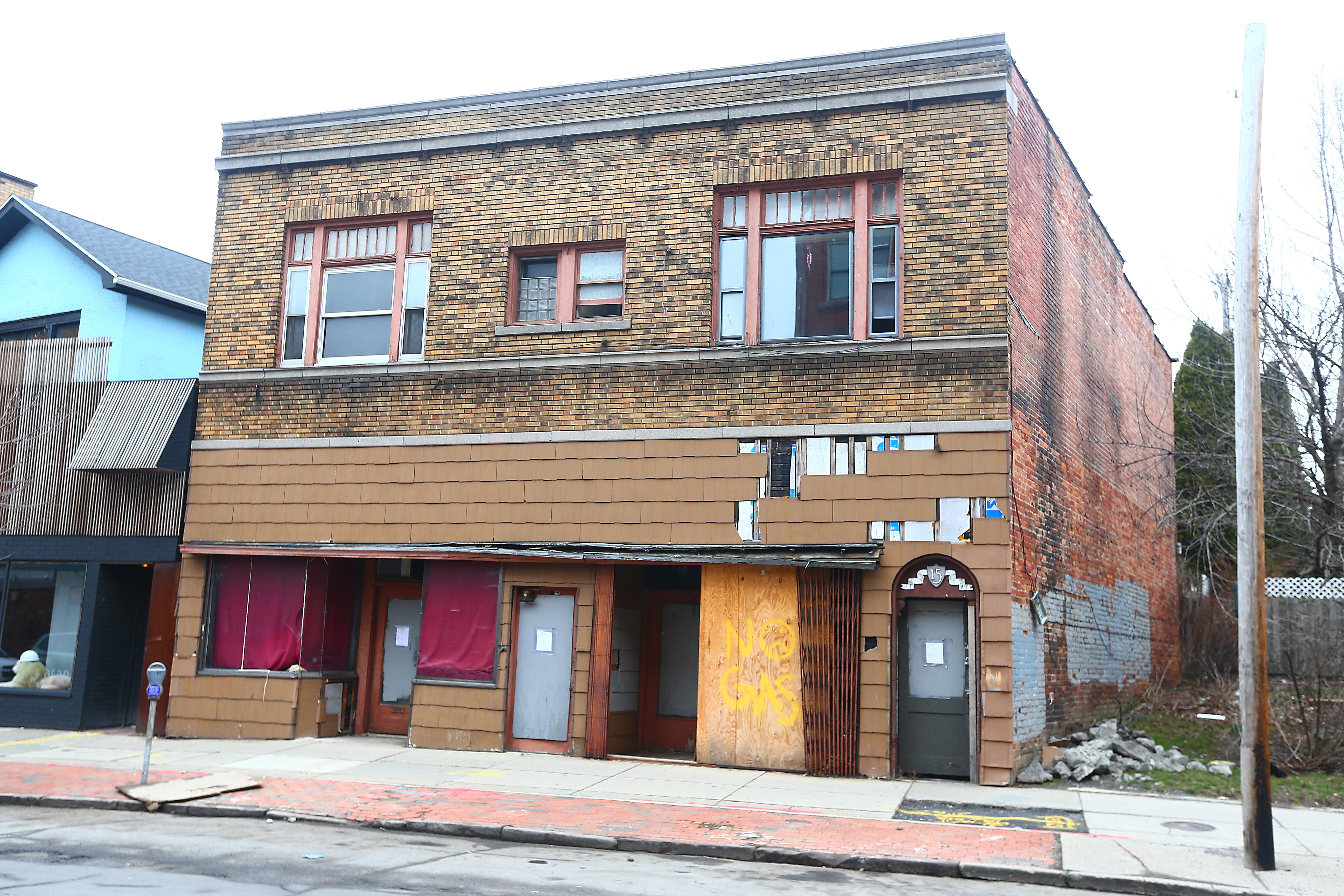 Owner May Wong had sought to demolish the two-story building at 15 Allen St., but the board's approval last week hinged on leaving the front wall standing to remain part of a streetscape that preservationists are vigilantly trying to keep intact. (John Hickey/Buffalo News)