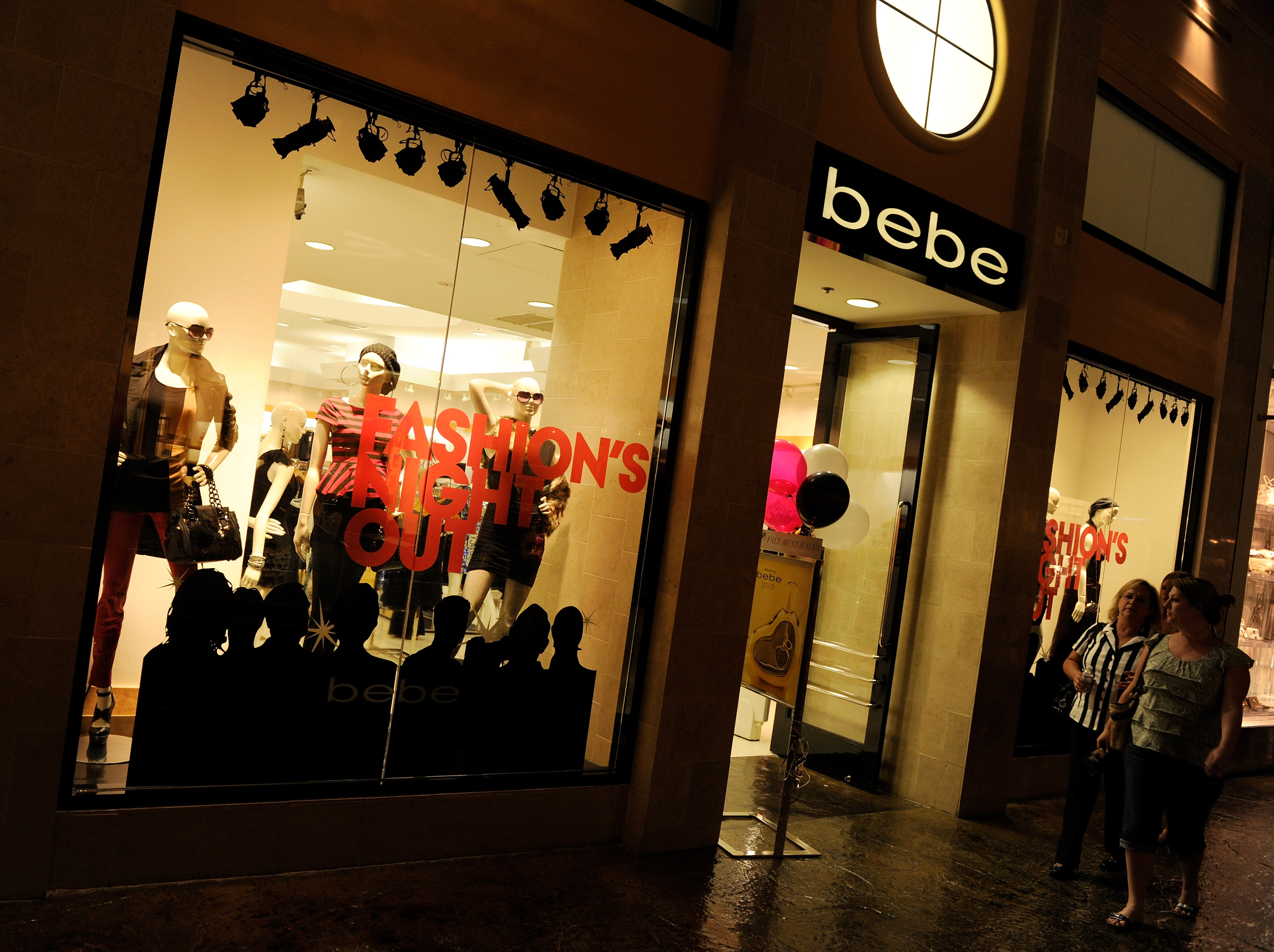 Customers walk by a Bebe store during Fashion's Night Out at The Forum Shops at Caesars in Las Vegas, Nevada.  (Getty Images)