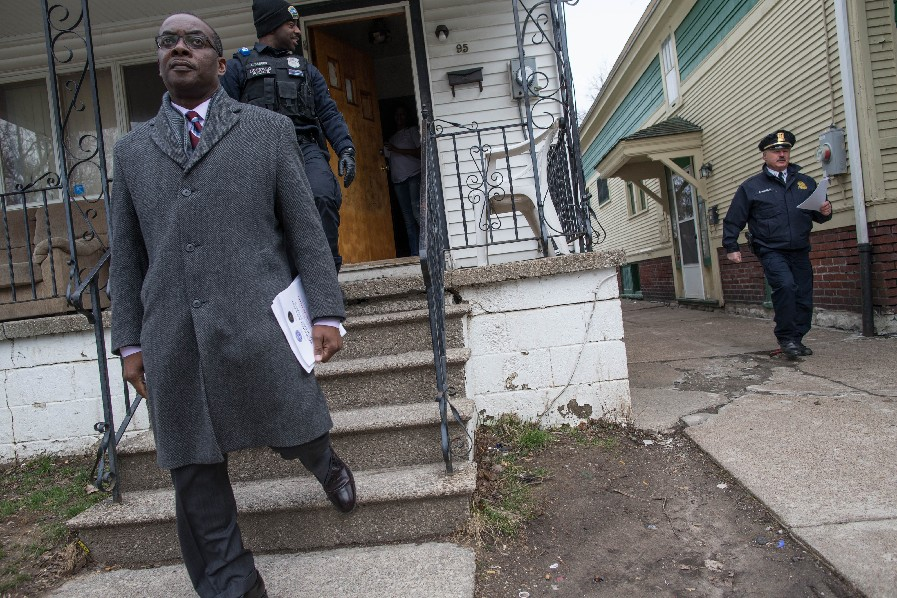 Buffalo Mayor Byron Brown, accompanied by Buffalo Police Officer Moe Badger and Capt. Steve Nichols go door-to-door on Eller Avenue as part of a campaign to solicit witnesses to come forward with information regarding a recent triple shooting in the neighborhood, Thursday, March 9, 2017. (Derek Gee/Buffalo News)