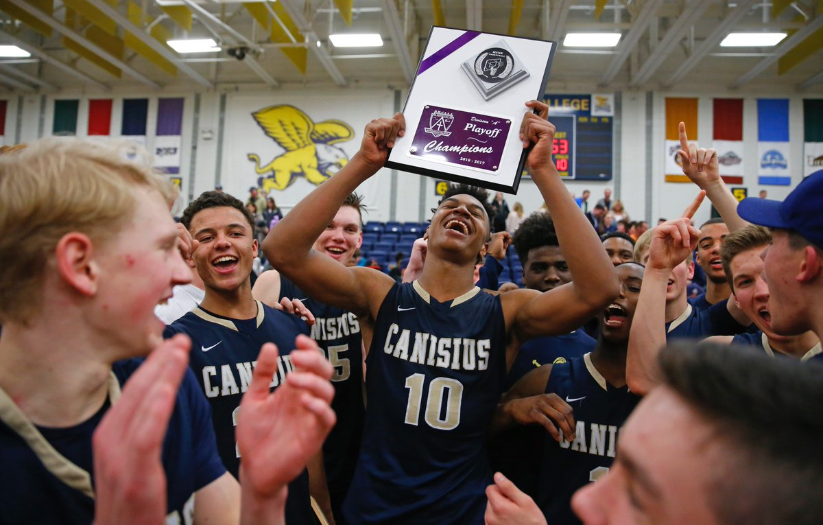 Jayce Johnson (10) and Colby Moultrie celebrate with their Canisius teammates and fans after capturing the Manhattan Cup Class A championship with a win over St. Francis on Wednesday night at Canisius College's Koessler Athletic Center. (Harry Scull Jr./Buffalo News)