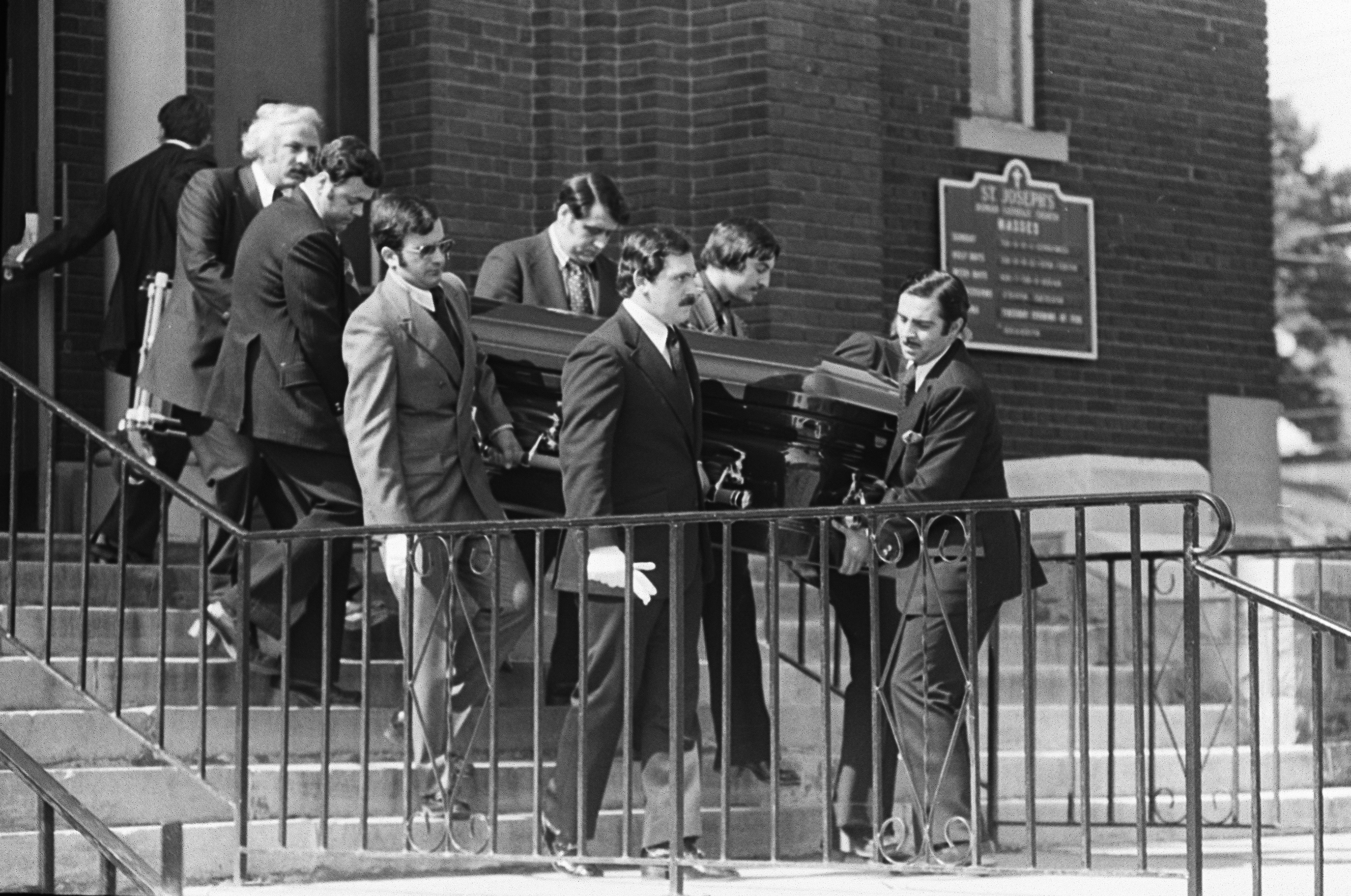 "Pallbearers carry the casket of Stefano Magaddino out of St. Joseph's Church in Niagara Falls in July 1974. ""He was a good family man, loved by a lot of people, but he was also a killer,"" said retired mob investigator George E. Karalus. (Mickey Osterreicher/Special to The News"