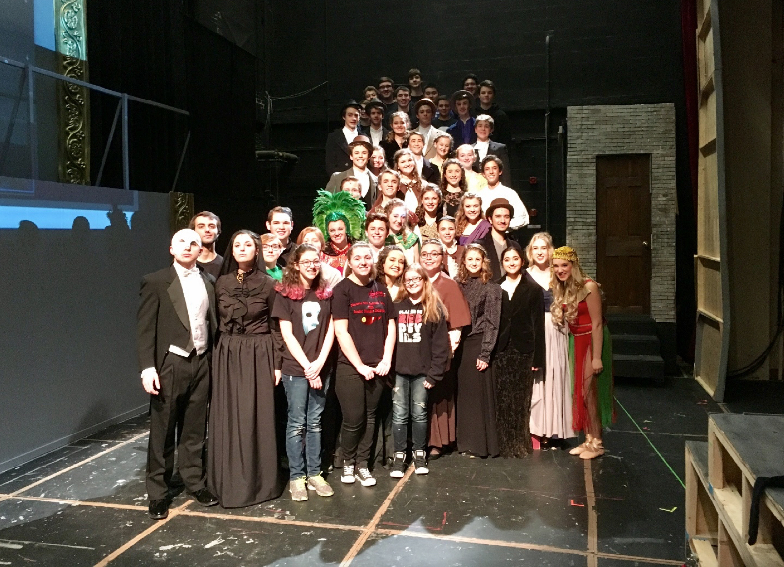 "The cast and crew of Clarence High School's production of ""Phantom of the Opera"". Raffi Wright, who plays the Phantom, seen at far left. Sarah Helbringer, who plays Christine, seen at far right."