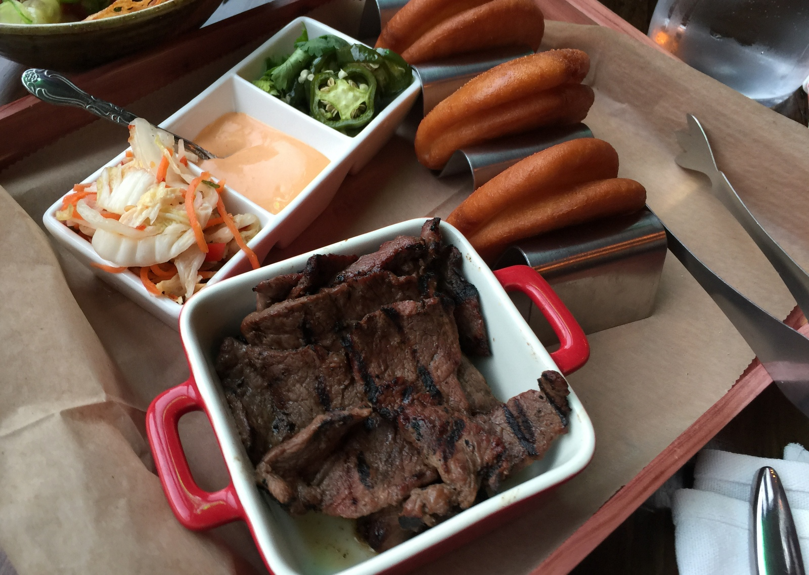 Crispy bao with grilled Korean short rib at Falley Allen. (Andrew Galarneau/Buffalo News)