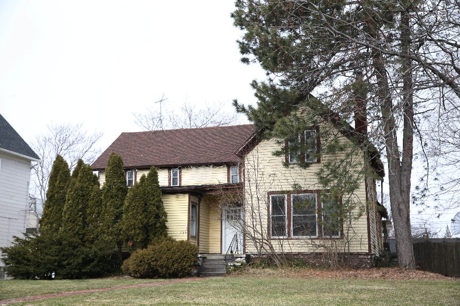 The owners of this 19th century farmhouse say granting it landmark status will make redevelopment of the site more difficult. (Sharon Cantillon/Buffalo News)