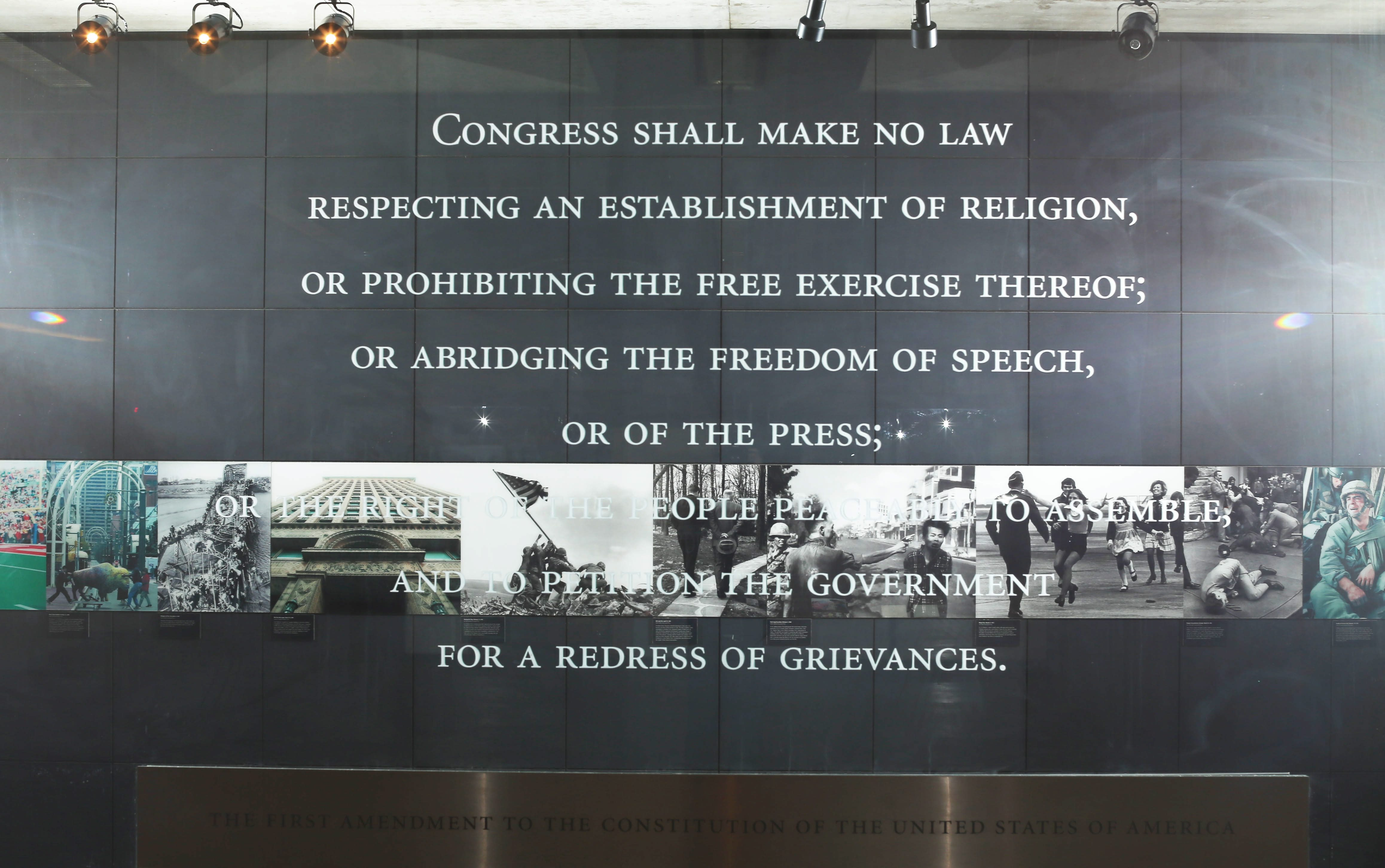 Etched on a glass wall, the First Amendment occupies a prominent place in the lobby of The Buffalo News. (Derek Gee/Buffalo News)
