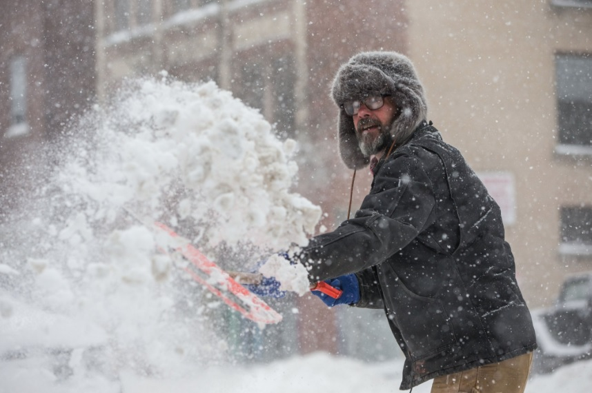 Donald Kinsman shovels out the sidewalk in Allentown as heavy snow continues to fall in Buffalo. (Derek Gee/Buffalo News)