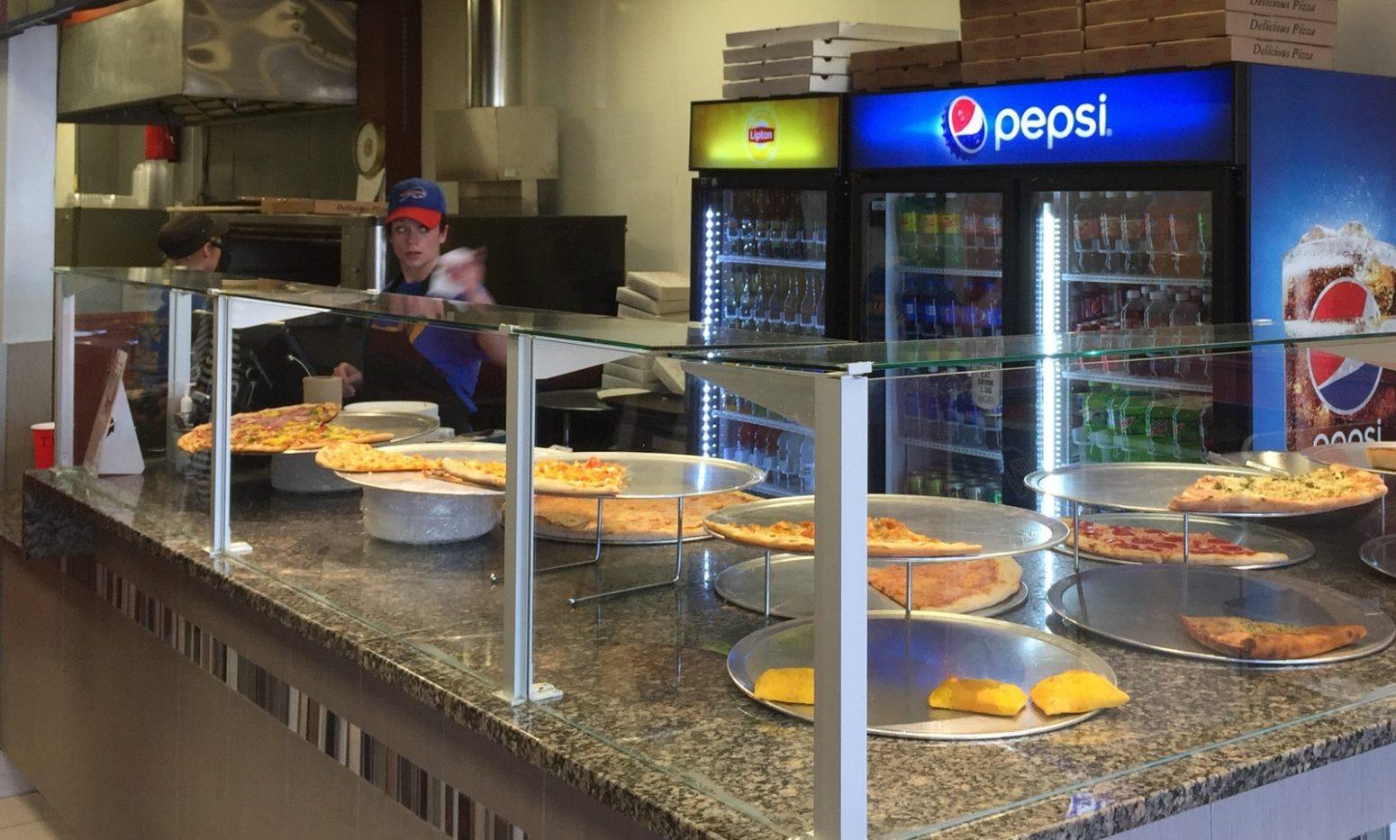 Pizzamaker from Albania opens store across Main Street from the University at Buffalo's Main Street campus. (Andrew Galarneau/Buffalo News)