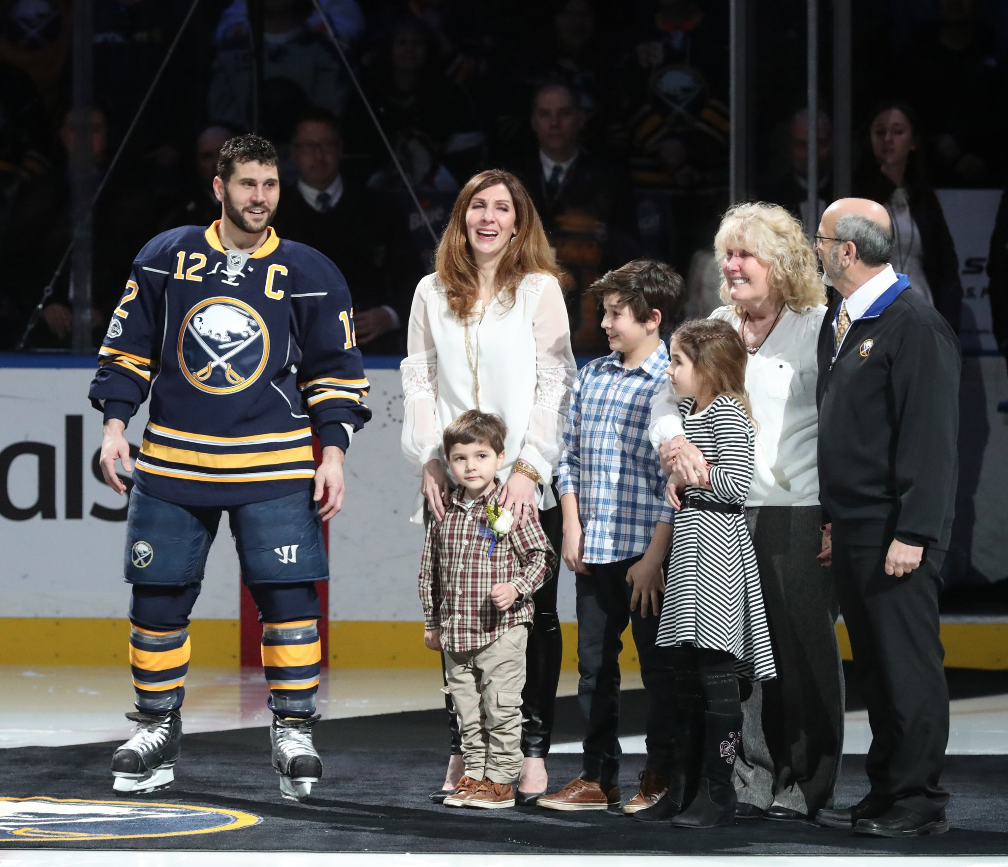Brian Gionta celebrated his 1,000th NHL game with his wife, Harvest, children James, Adam and Leah, and his parents, Penny and Sam. (James P. McCoy/Buffalo News)