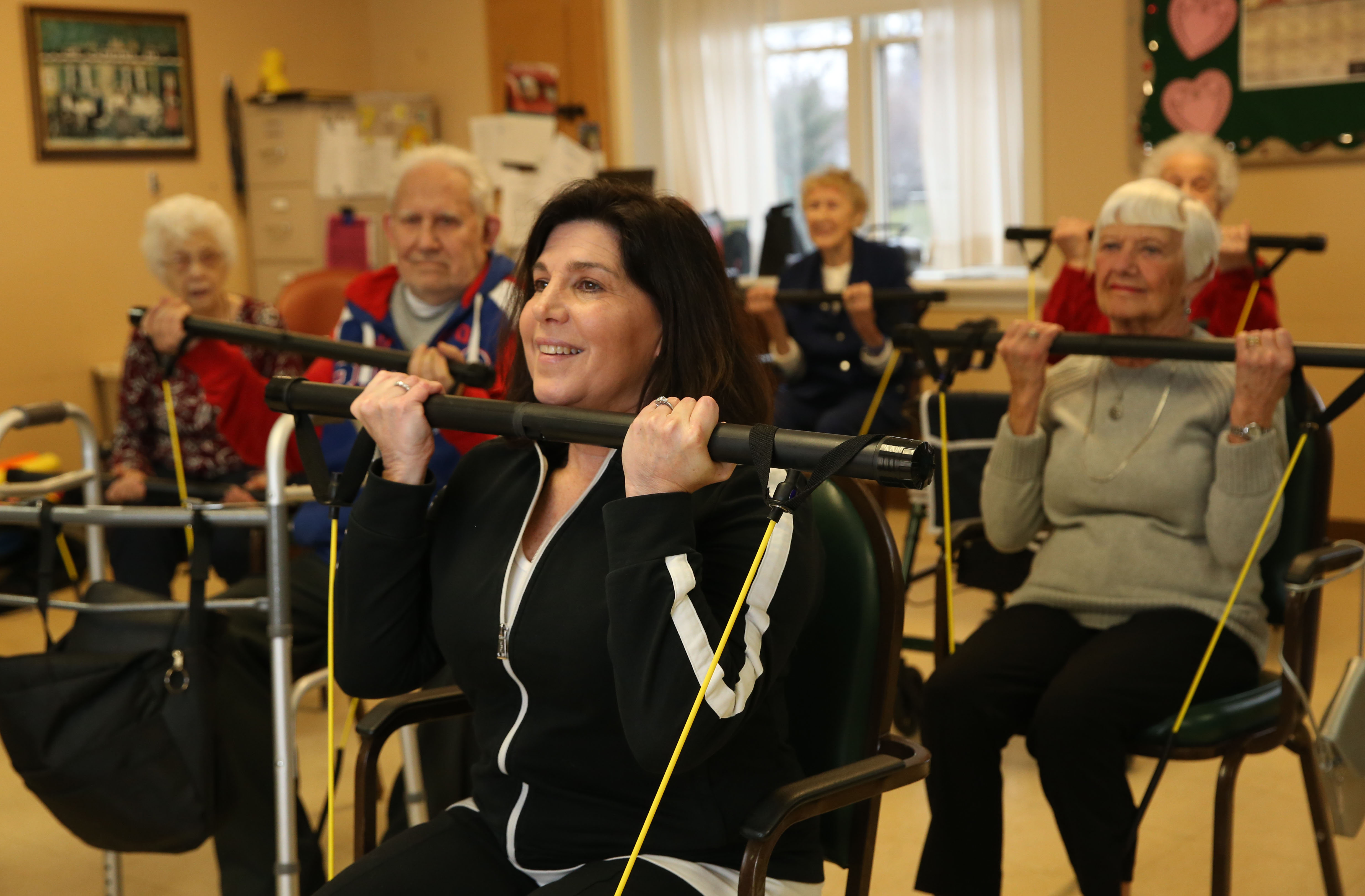 Elderwood Village at Williamsville residents, including those who have trouble walking, take fitness classes from Jill Bronsky, which helps improve balance and lower the risk of falling. She'll sign her new book at the facility on Thursday. (Photo by Sharon Cantillon/Buffalo News)