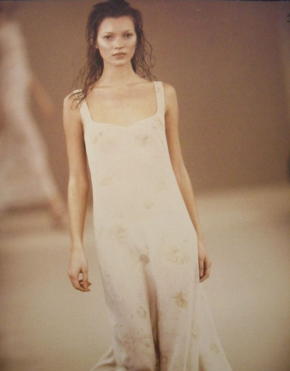 A handout photo of Kate Moss in a dress during the Calvin Klein Collection Spring 1993 runway show.