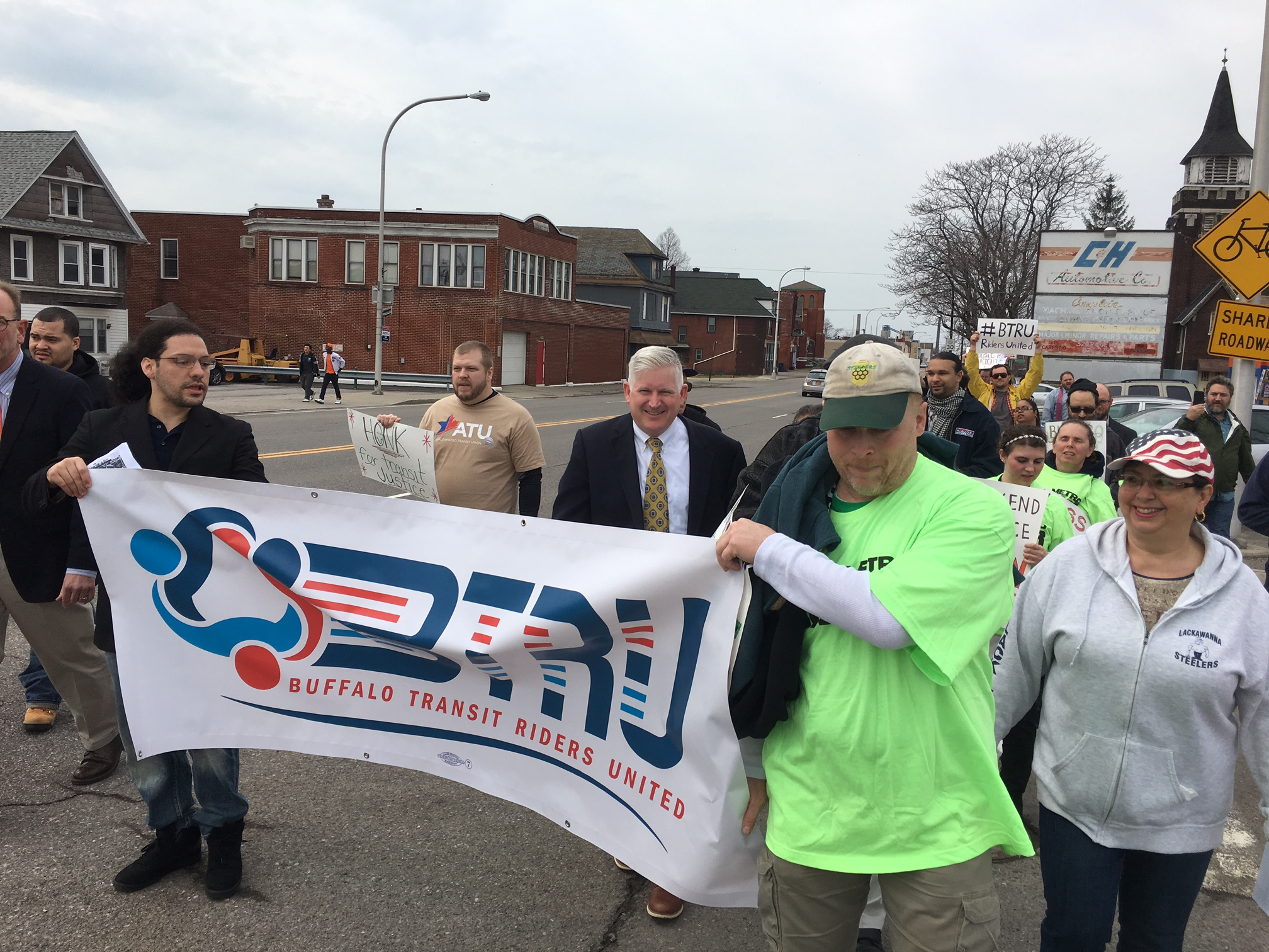 Transit riders march along Ridge Road from Lackawanna's first ward, toward a bus stop on South Park Avenue