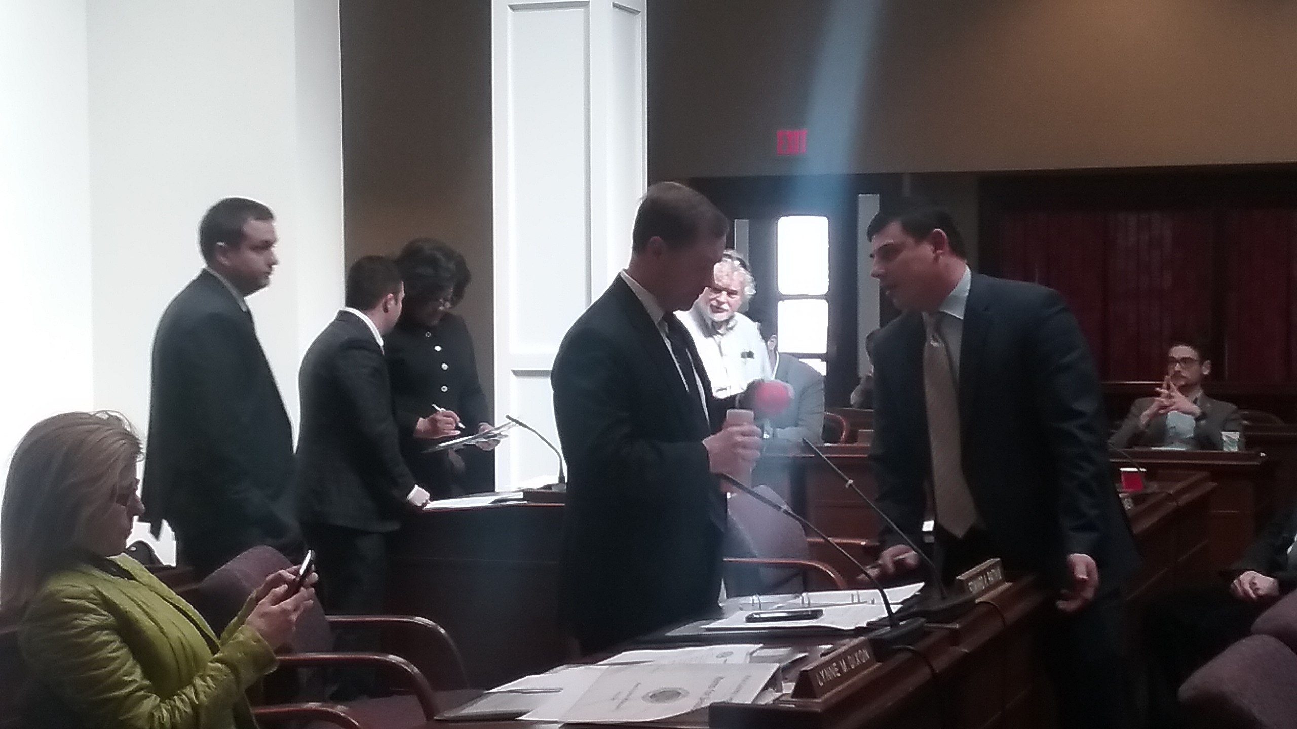 Legislators meet and confer at a recess to discuss amendments to a borrowing deal for ECMC. (Sandra Tan/Buffalo News)