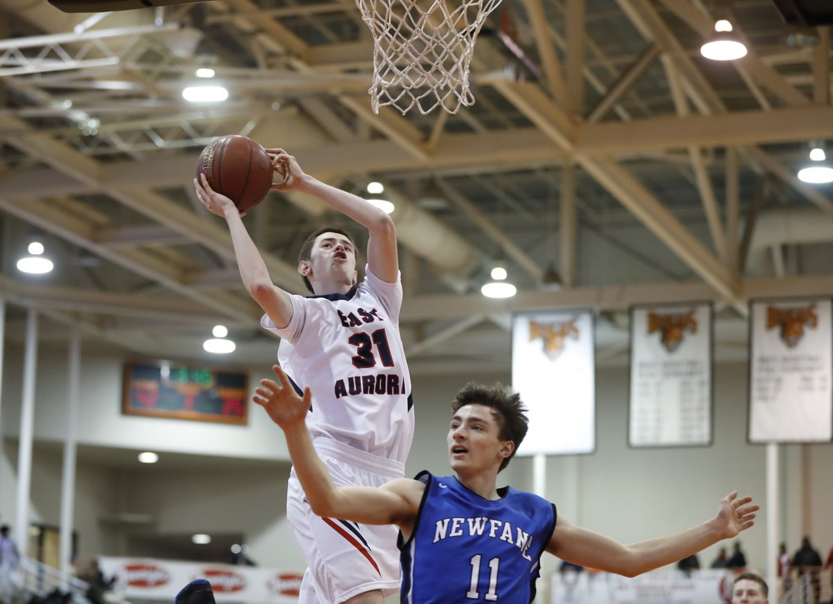 Cal McTigue scores two of his 20 points for East Aurora in its Class B-1 championship game win over Newfane on Saturday. (Harry Scull Jr./Buffalo News)