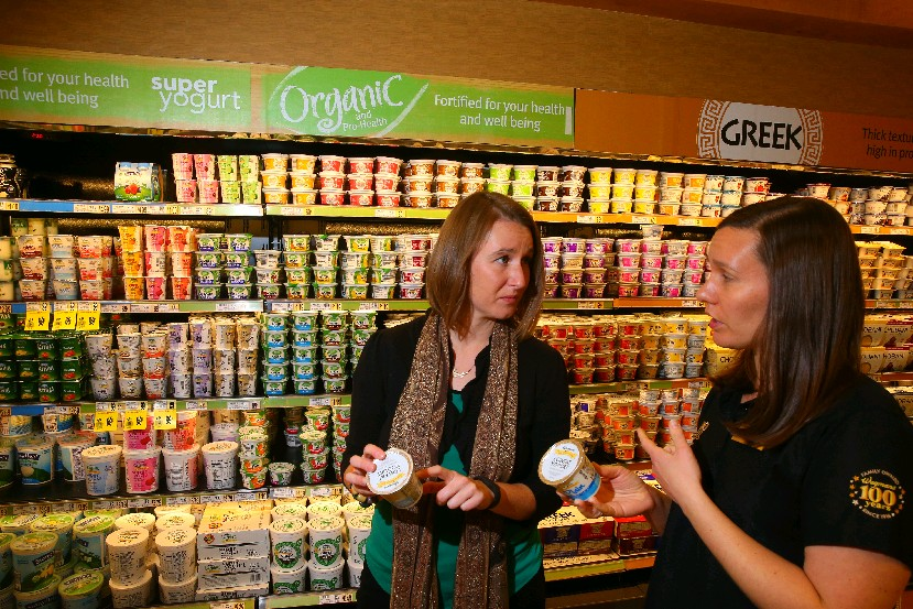 Nicole Klem, left, chair of the Nutrition and Dietetics Department at Trocaire College, and Mallary Whipple, Wegmans divisional nutritionist, and a registered dietitian, recommend pairing fresh fruits with plain yogurt. (John Hickey/Buffalo News)