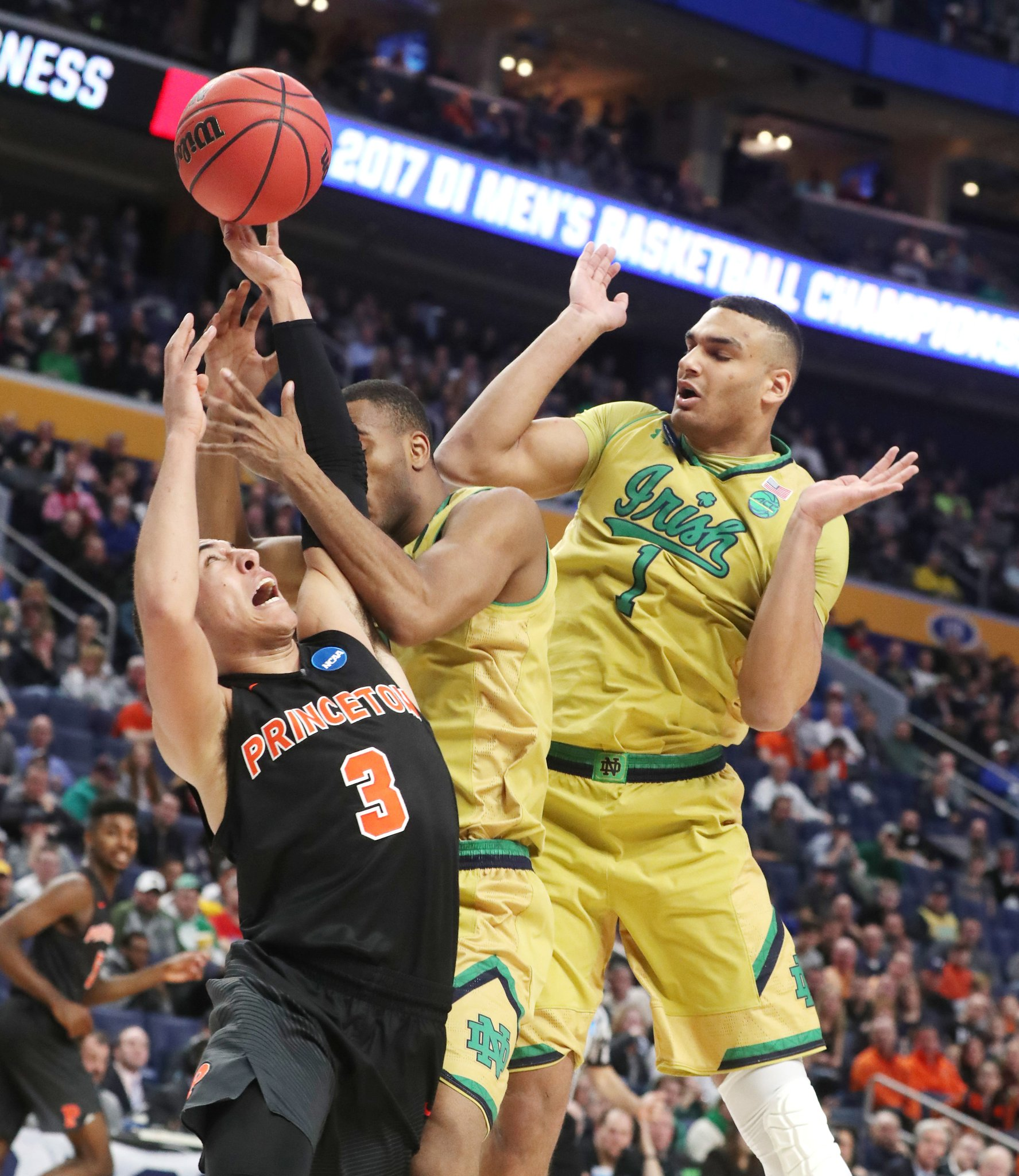 Notre Dame's V.J. Beachem battles Princeton Tigers guard Devin Cannady. (James P. McCoy/Buffalo News)