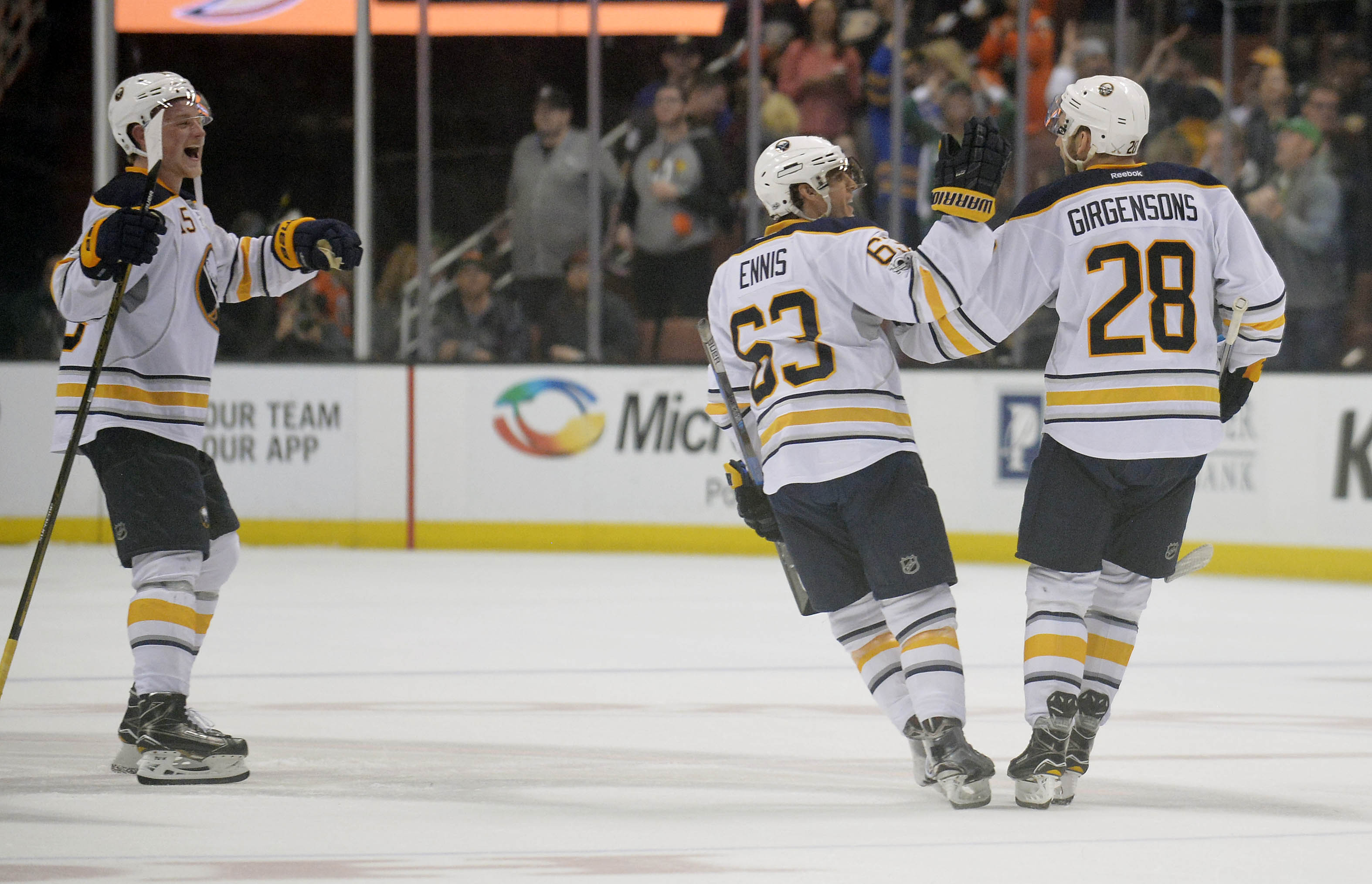 Jack Eichel and Tyler Ennis congratulate Zemgus Girgensons on his shootout-winning goal (USA Today Sports).