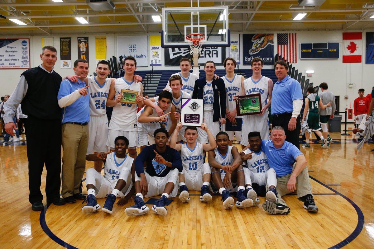St. Mary's celebrates winning its first Manhattan Cup title after defeating Nichols in the Class B final on Wednesday night. (Harry Scull Jr./Buffalo News)