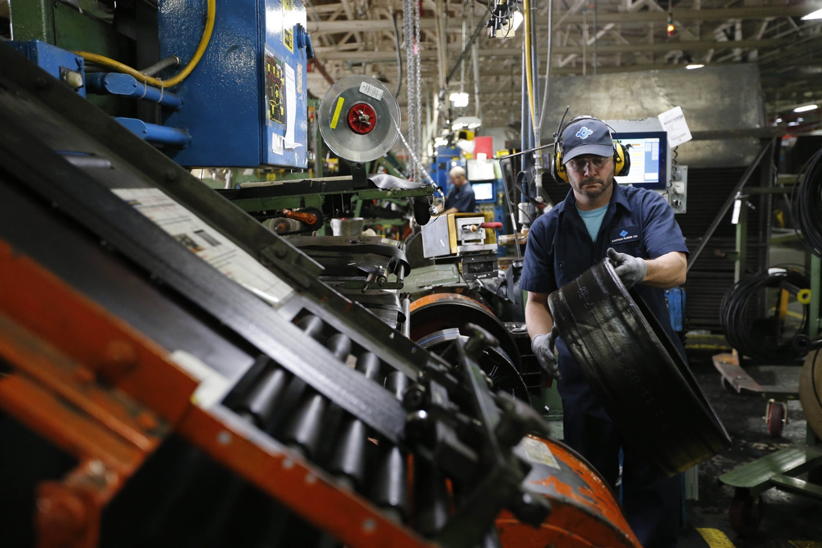 Tire builder Kevin Varney assembles a motorcycle tire at the Sumitomo Rubber USA tire manufacturing plant in Tonawanda in November. (Derek Gee/ Buffalo News file photo)