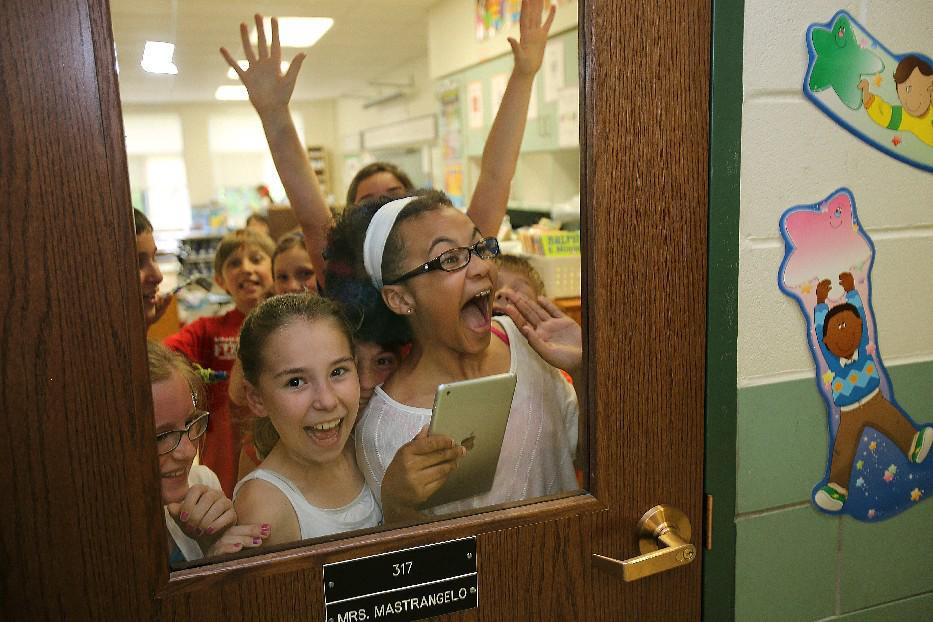 Students at Union Pleasant Elementary School in Hamburg in 2014 watch for a visit by Buffalo Bill Mario Williams as part of the M&T Bank Touchdown for Teachers program. (Buffalo News file photo)