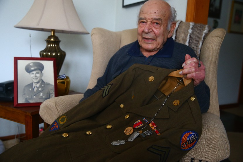 World War II vet Angelo C. Ianni is proud of his service but still troubled by memories of the bones of Japanese civilians who jumped to their deaths because of fear of the Americans. (John Hickey/Buffalo News)