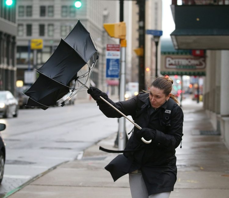 Karen McArthur's was confident in the industrial-strength umbrella her mother gave her, but it was no match for the wind in downtown Buffalo on Washington Street last Wednesday afternoon. McArthur, of Depew, works downtown. It will be another windy Wednesday today, forecasters at the National Weather Service warn. (Sharon Cantillon/Buffalo News)