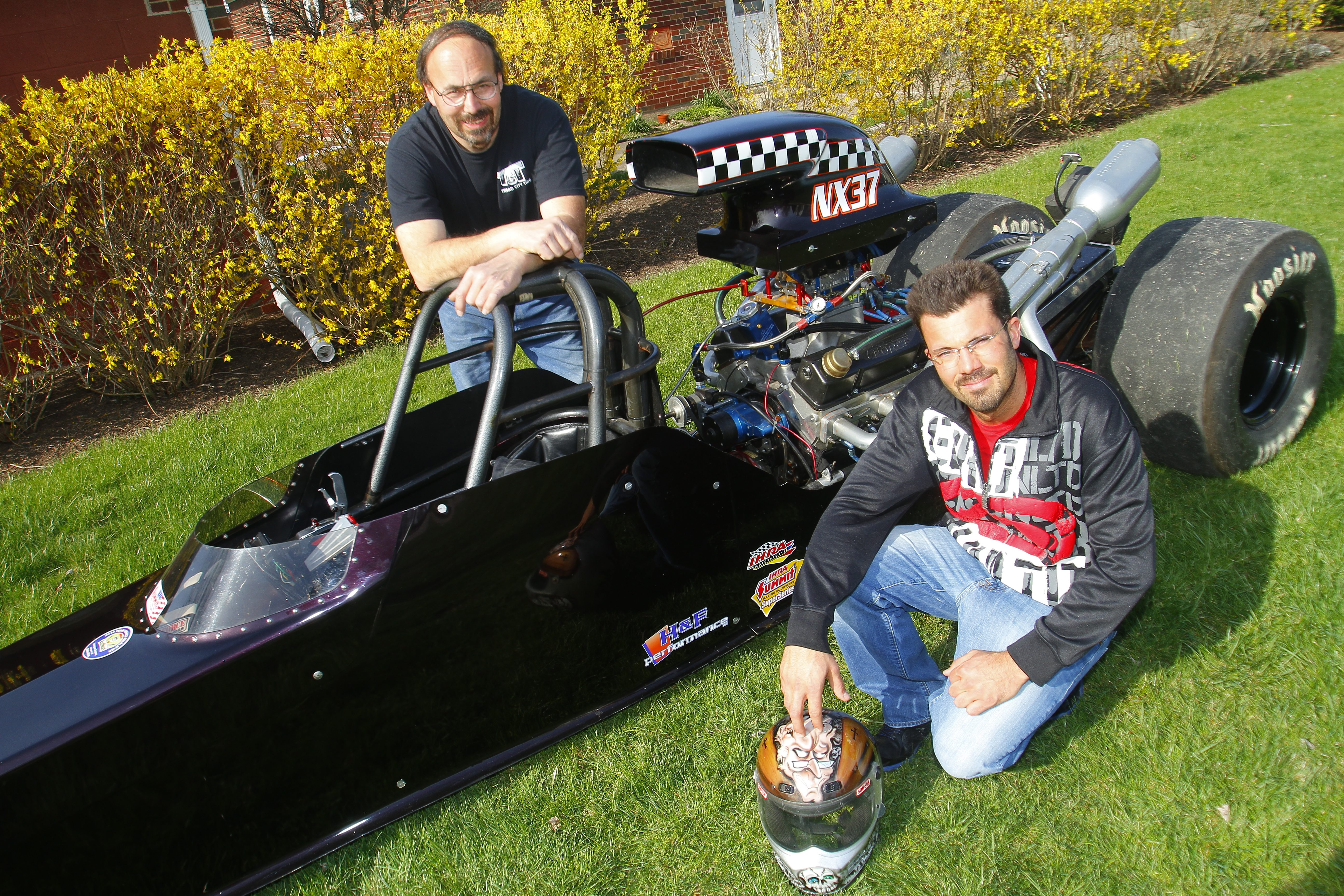 Pete Maduri Jr., right,   with his car and his father Pete Maduri Sr., in a 2013 file photo. {John Hickey/Buffalo News}