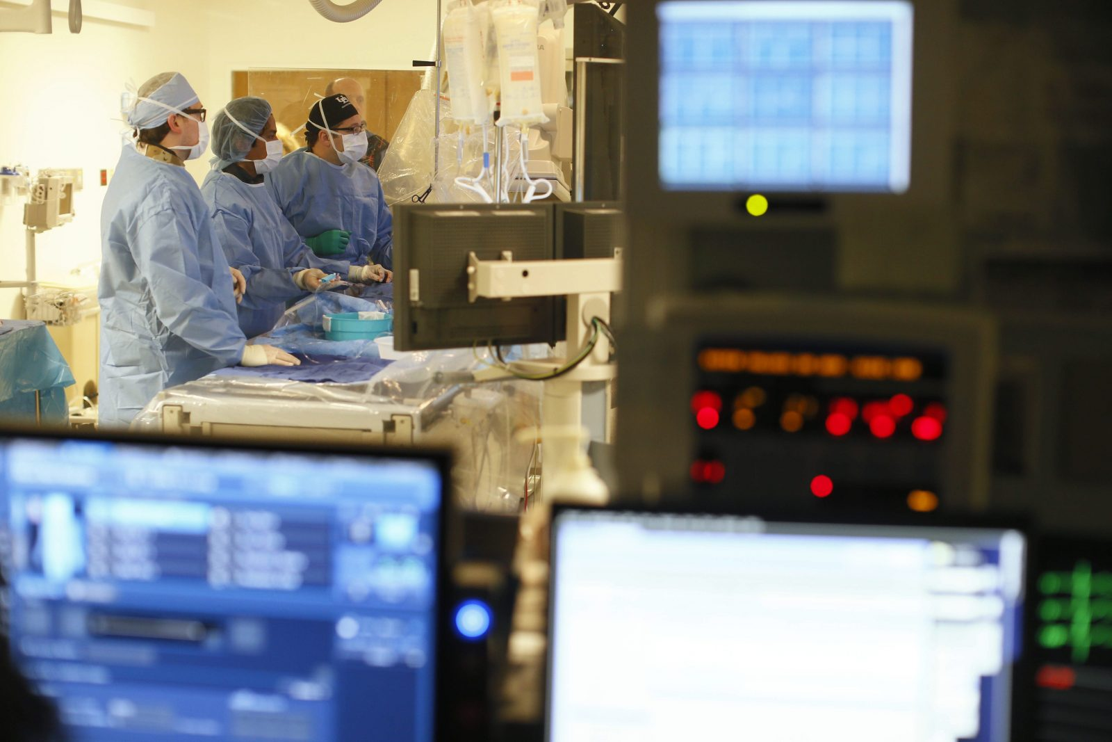 Erie County's Medicaid costs offer evidence of the continuing need to reform American health care. In this photograph, neurosurgeons remove a blockage from an artery of a stroke patient at Gates Vascular Institute.  (Derek Gee/Buffalo News file photo)