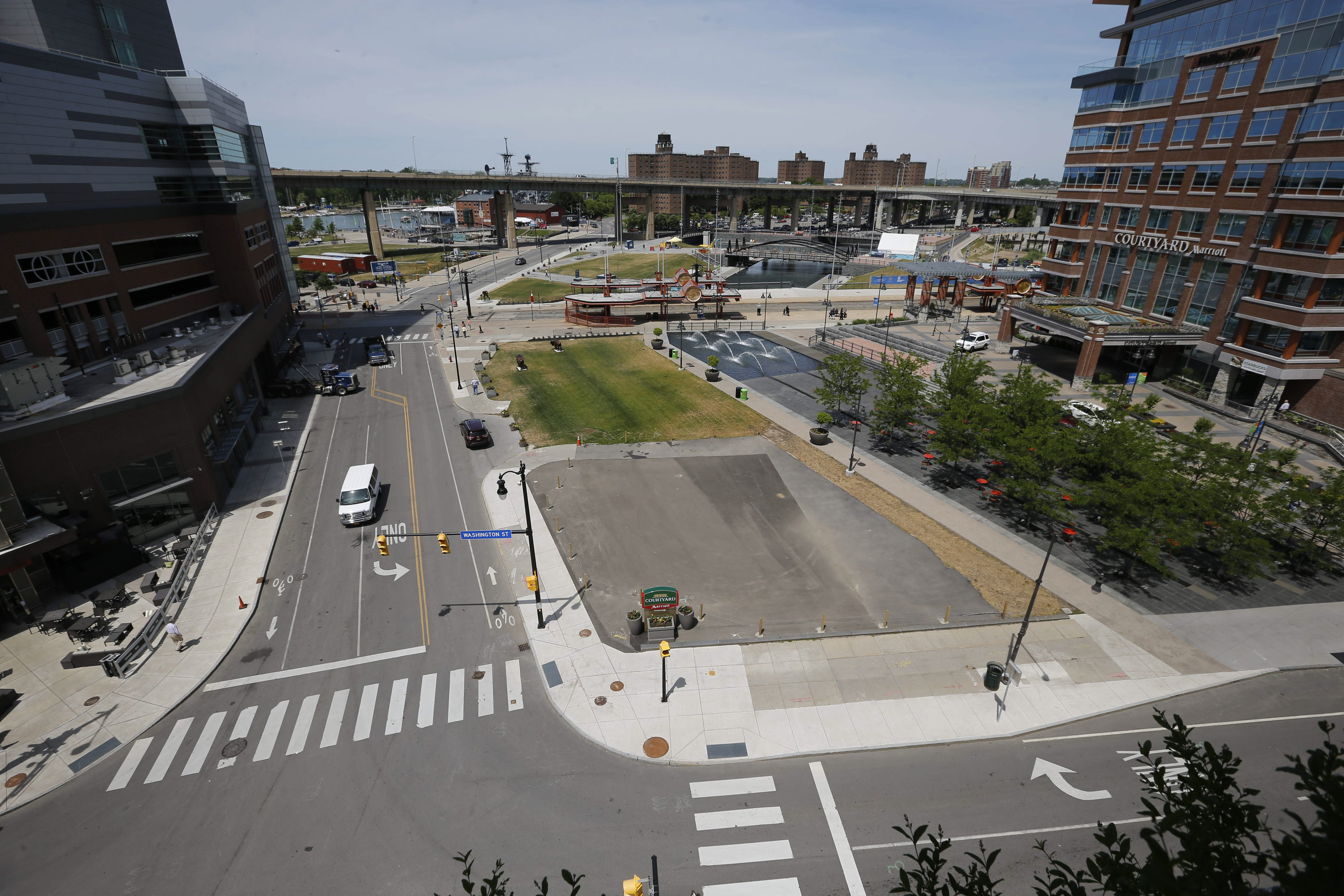 The site where Benderson is proposing a development at the corner of Washington and Scott streets. (Derek Gee/Buffalo News)