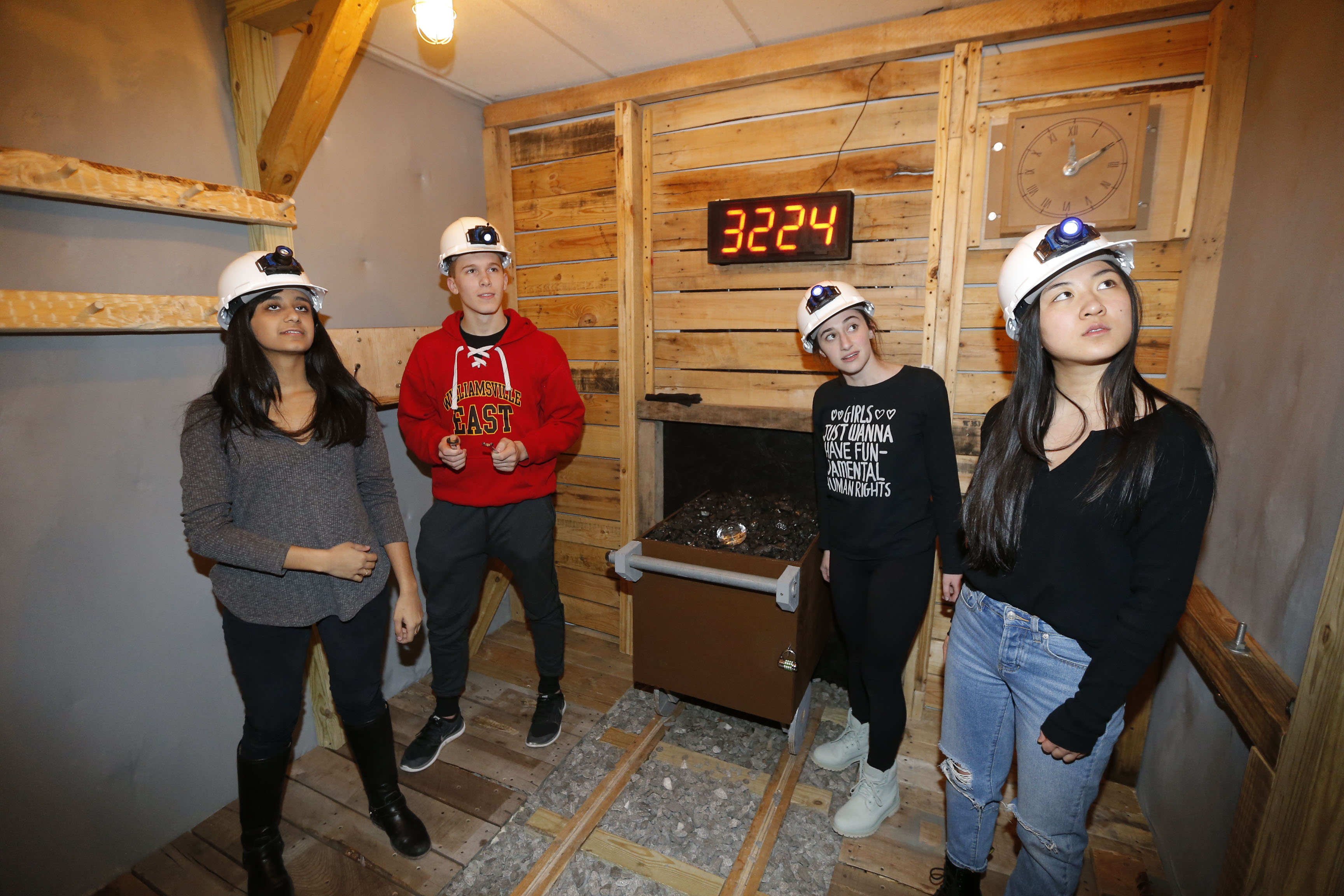 From left, Sarina Divan, 17, Timmy Finley, 18, Morgan Awner, 18, and Rachel Qiao, 17 work together to try and find clues in one of the rooms at 3600 Escape on Hertel Ave. in Buffalo onTuesday, March 28, 2017.  (Robert Kirkham/Buffalo News)