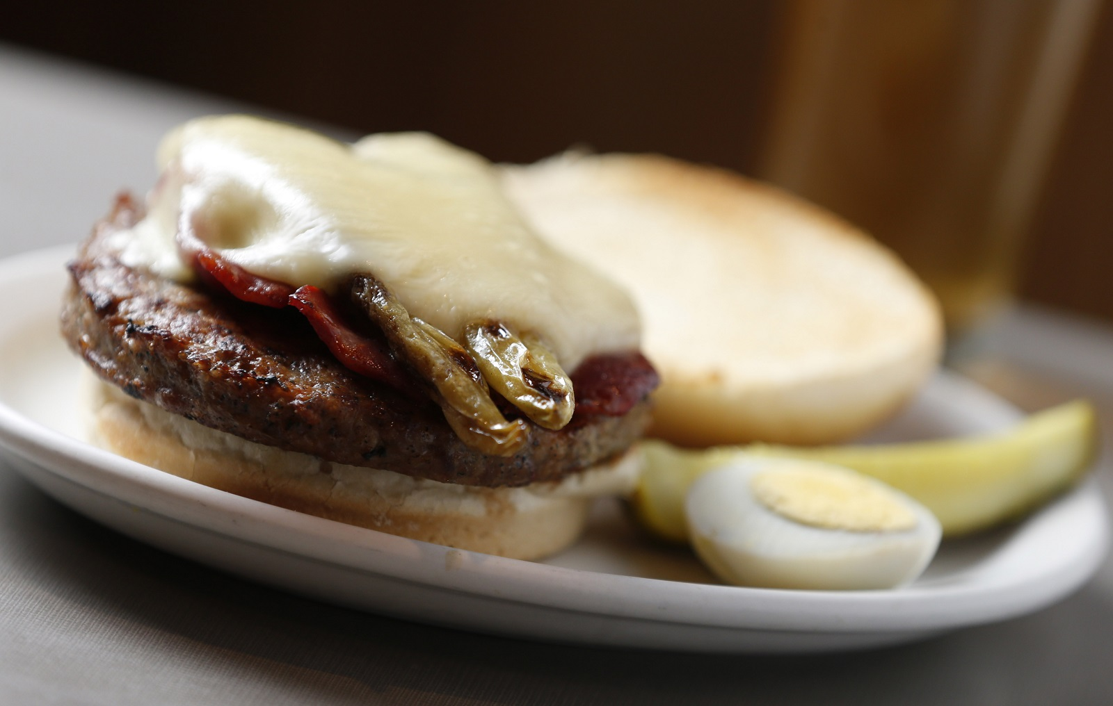 One of DiTondo's popular dishes is the Sausage Special.  It's an Italian sausage pattie on a hard roll and topped with capicola, hot banana peppers and provolone. (Sharon Cantillon/Buffalo News)