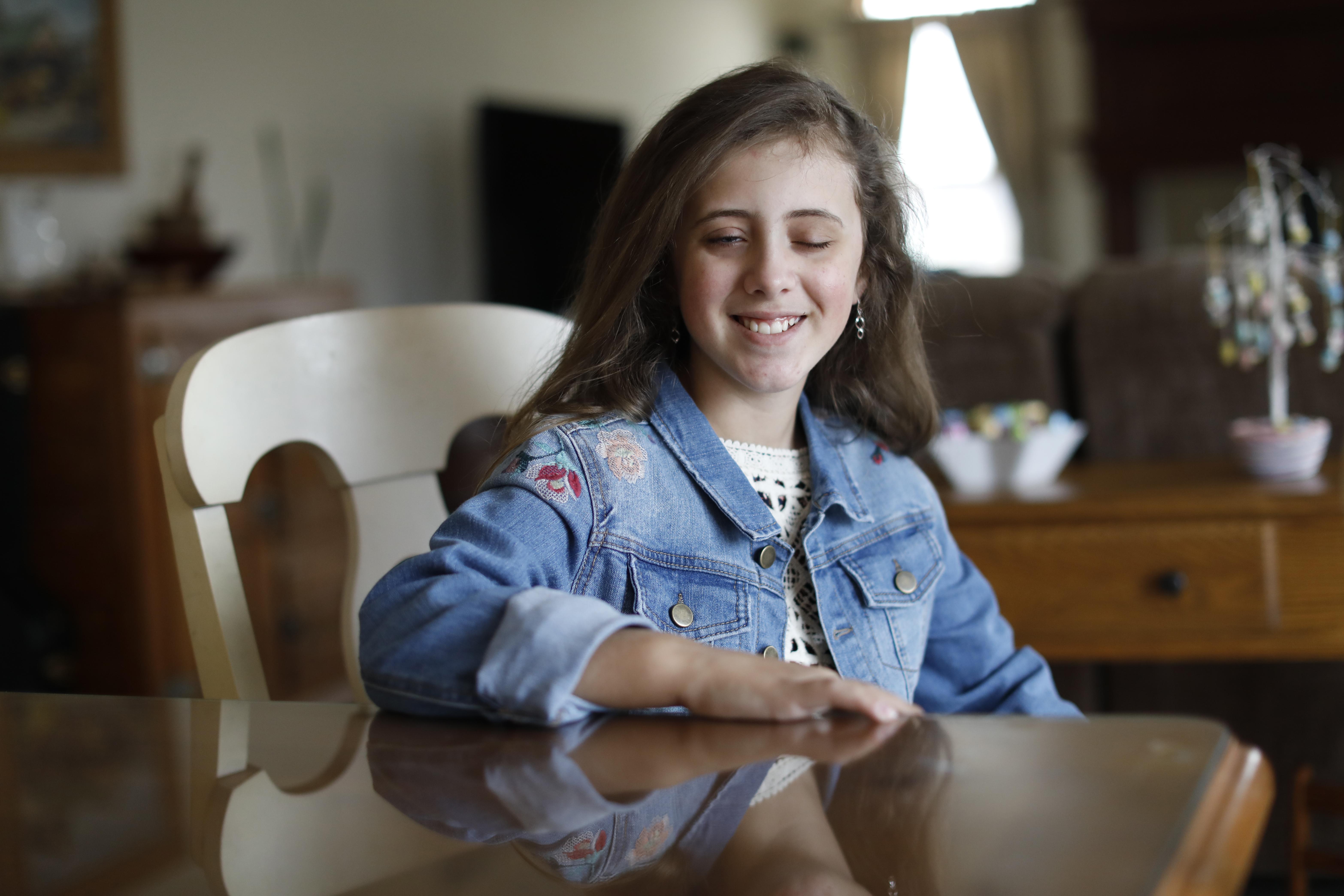 Annie Leeds, 12, of Lockport has severe mitochondrial disorder. (Derek Gee/Buffalo News)