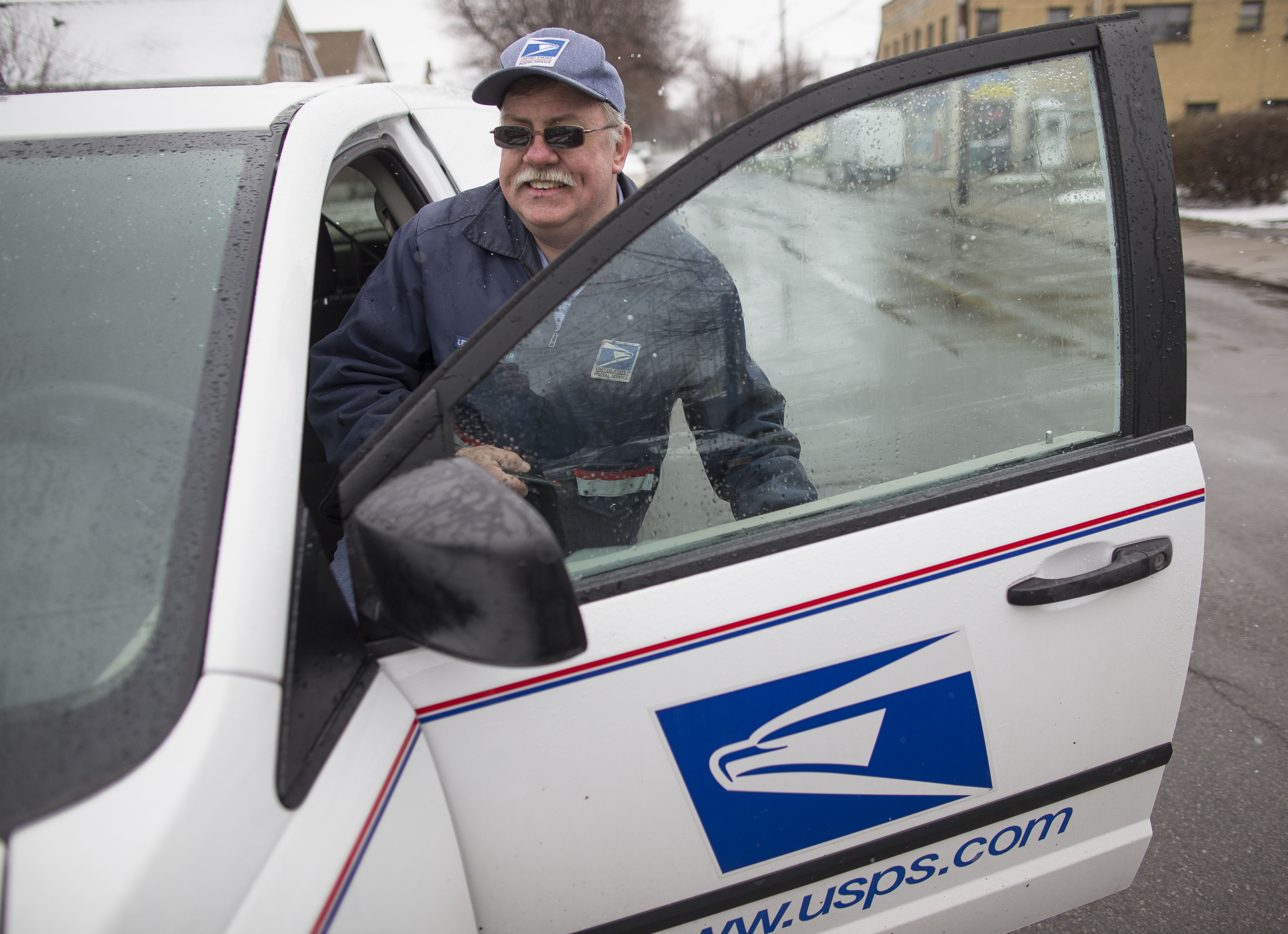 Postal carrier Randy Kowal was injured by a dog while delivering mail in 2013.  Despite two surgeries on his shoulder and near constant pain, he is back to work on light duty, Friday, April 7, 2017.  (Derek Gee/Buffalo News)