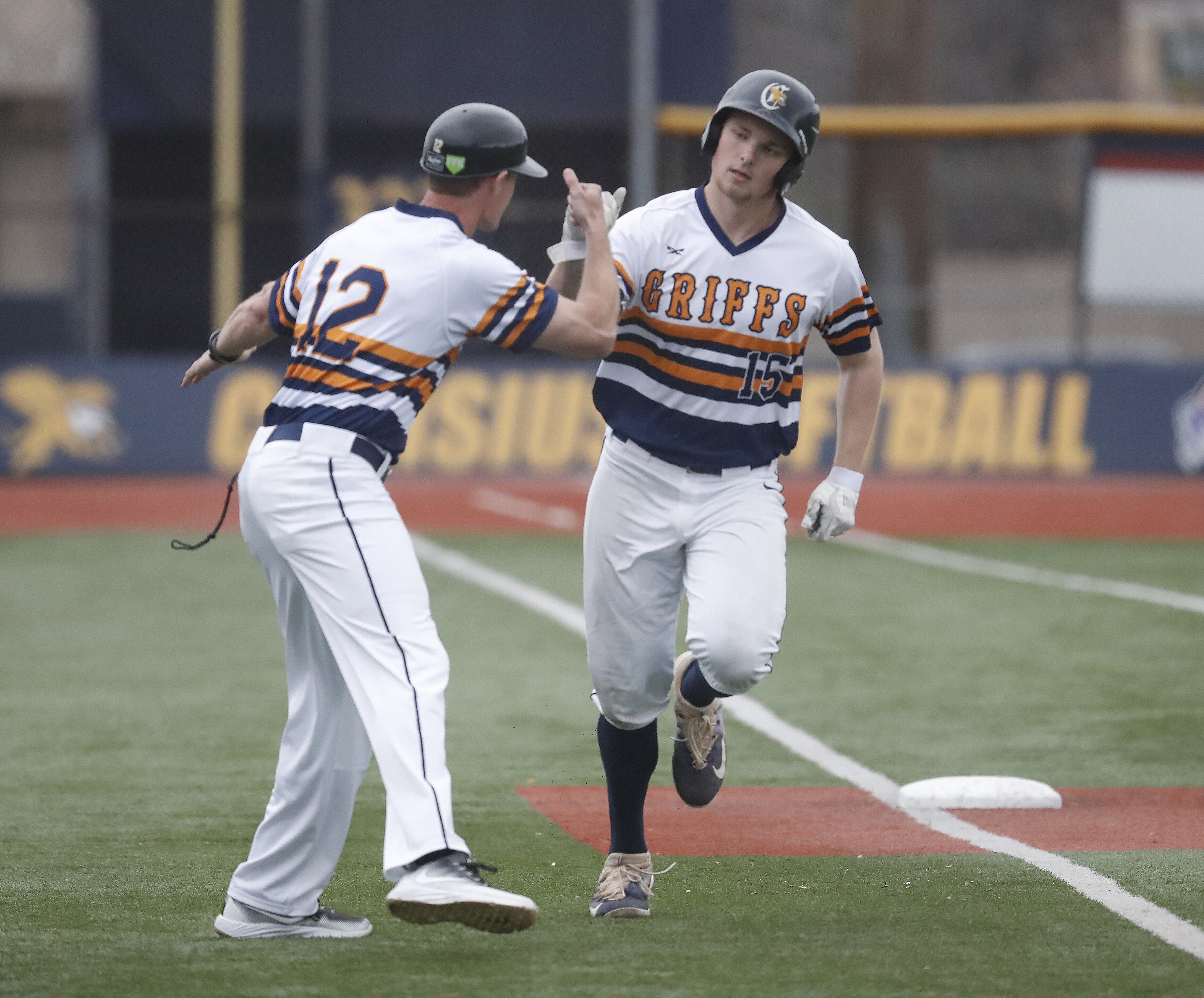 Canisius player Ryan Stekl is congratulated on his two- run walk-off homer against UB by assistant coach Matt Mazurek Tuesday at the Demske Sports Complex. (Harry Scull Jr./Buffalo News)