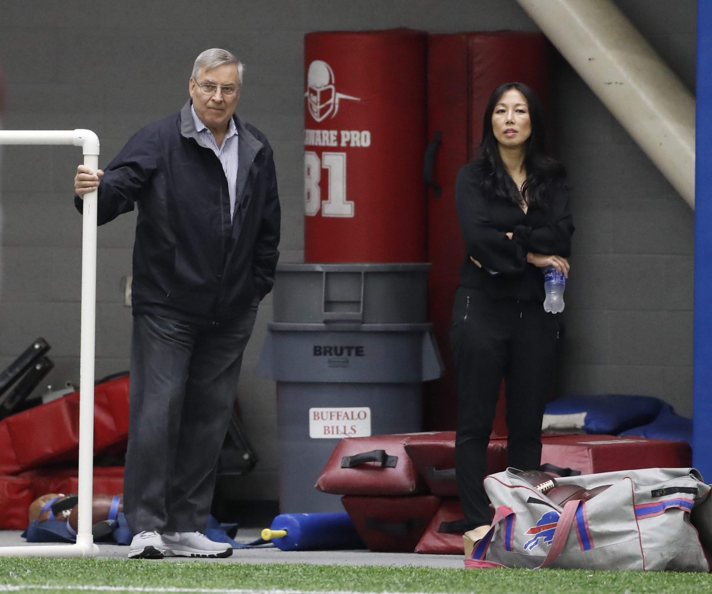 On a tumultuous day in Buffalo sports, Terry and Kim Pegula watched the Bills practice. (Harry Scull Jr./Buffalo News)