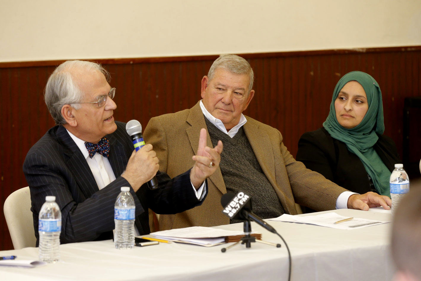 A panel, from left, Dr. Khalid J. Qazi, Lee Coppola  and Gamileh Jamil discusses journalism and Islam. (Robert Kirkham/Buffalo News)