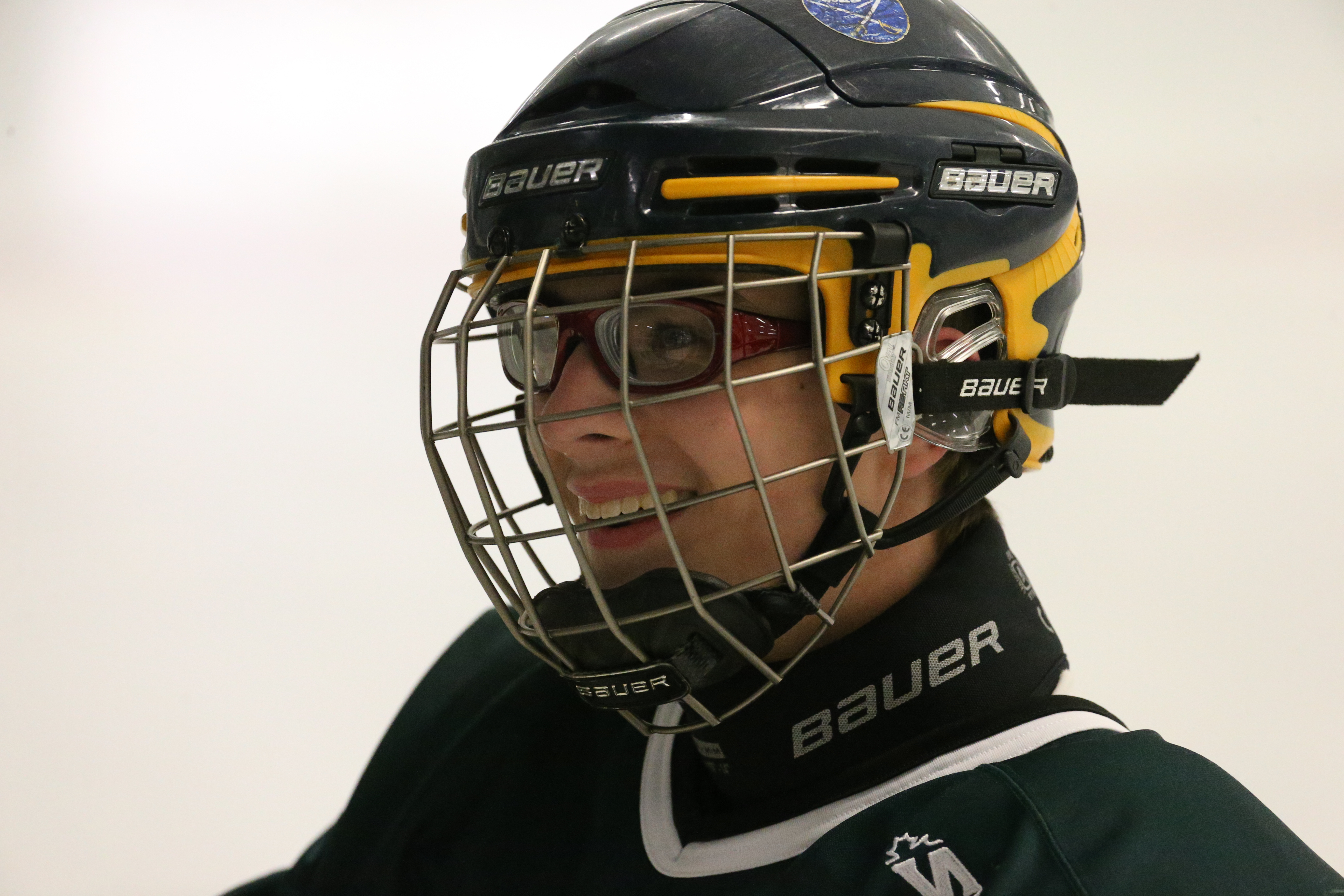 Williamsvile North team manager and sled hockey player Matt Henry helped organize a sled game between the state champion Spartans and the Buffalo Sabres intermediate gold team.  (James P. McCoy/Buffalo News)