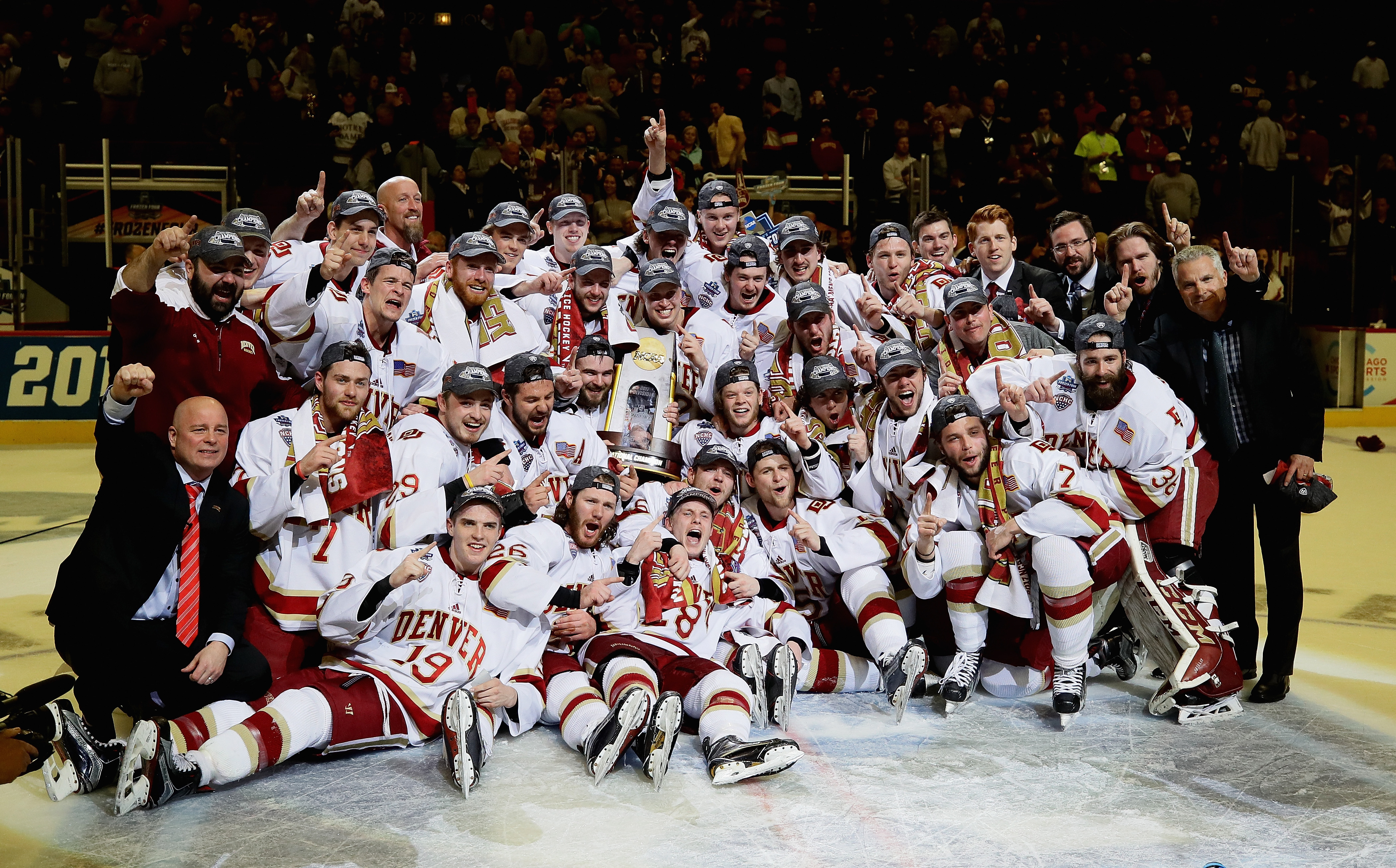The University of Denver hockey team poses after winning the NCAA championship Saturday in Chicago. (Getty Images)