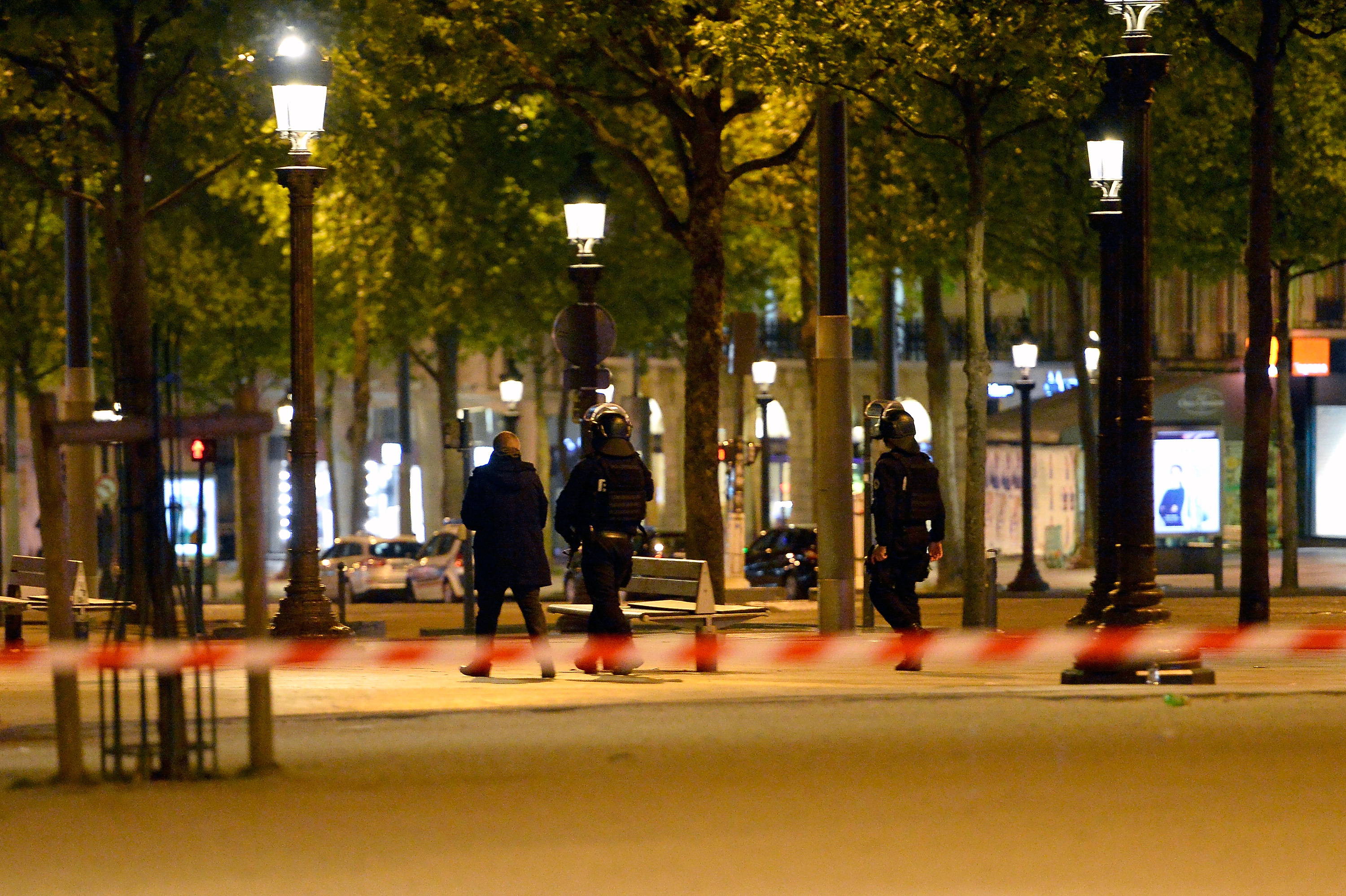 Police officers secure the area after a gunman opened fire on Champs Elysees on April 20, 2017 in Paris, France. (Photo by Aurelien Meunier/Getty Images)