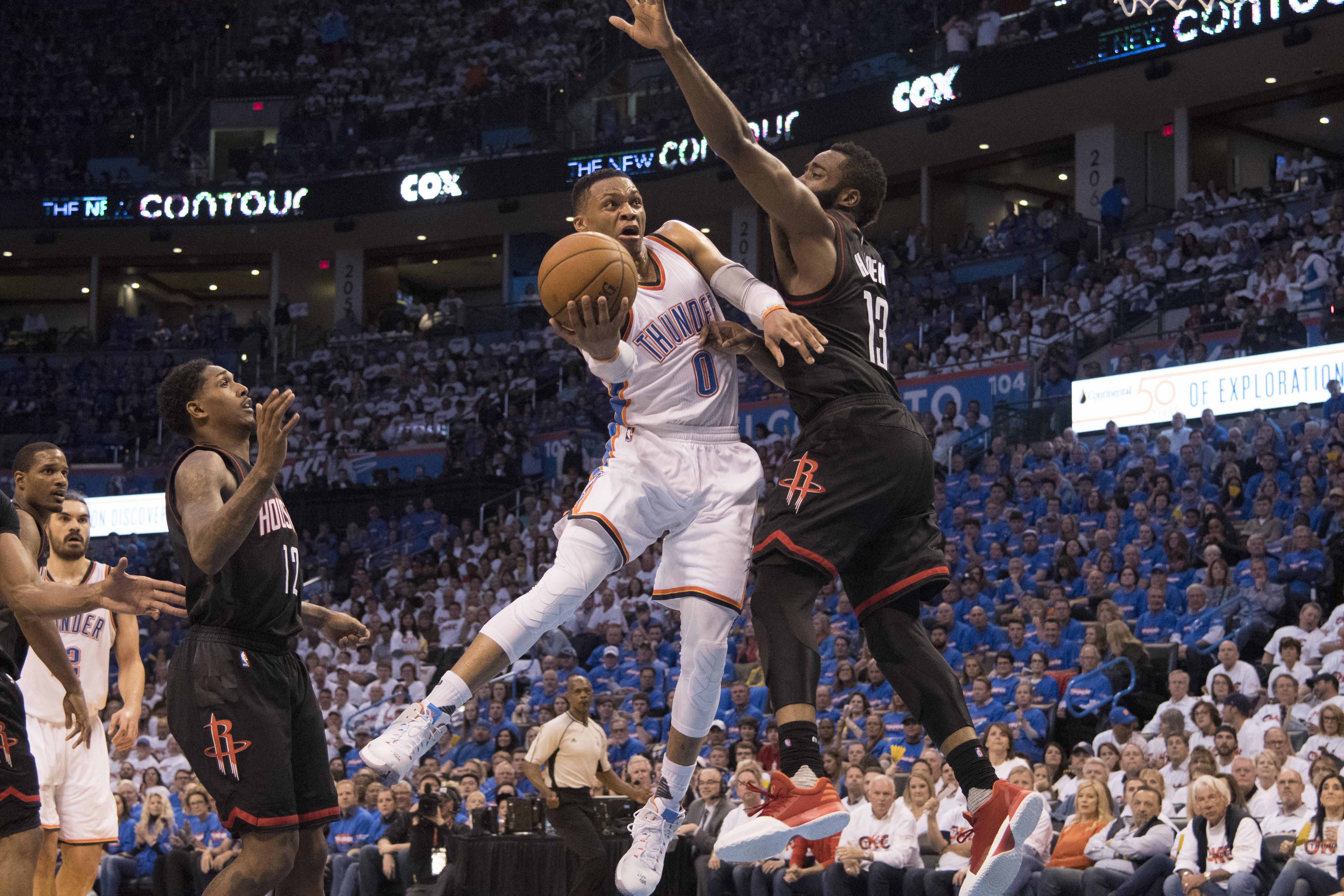 Russell Westbrook of the Oklahoma City Thunder drives around James Harden of the Houston Rockets for two points  during the second half of Game Three in the 2017 NBA Playoffs Western Conference Quarterfinals  on April 21, 2017 in Oklahoma City. (Photo by J Pat Carter/Getty Images)
