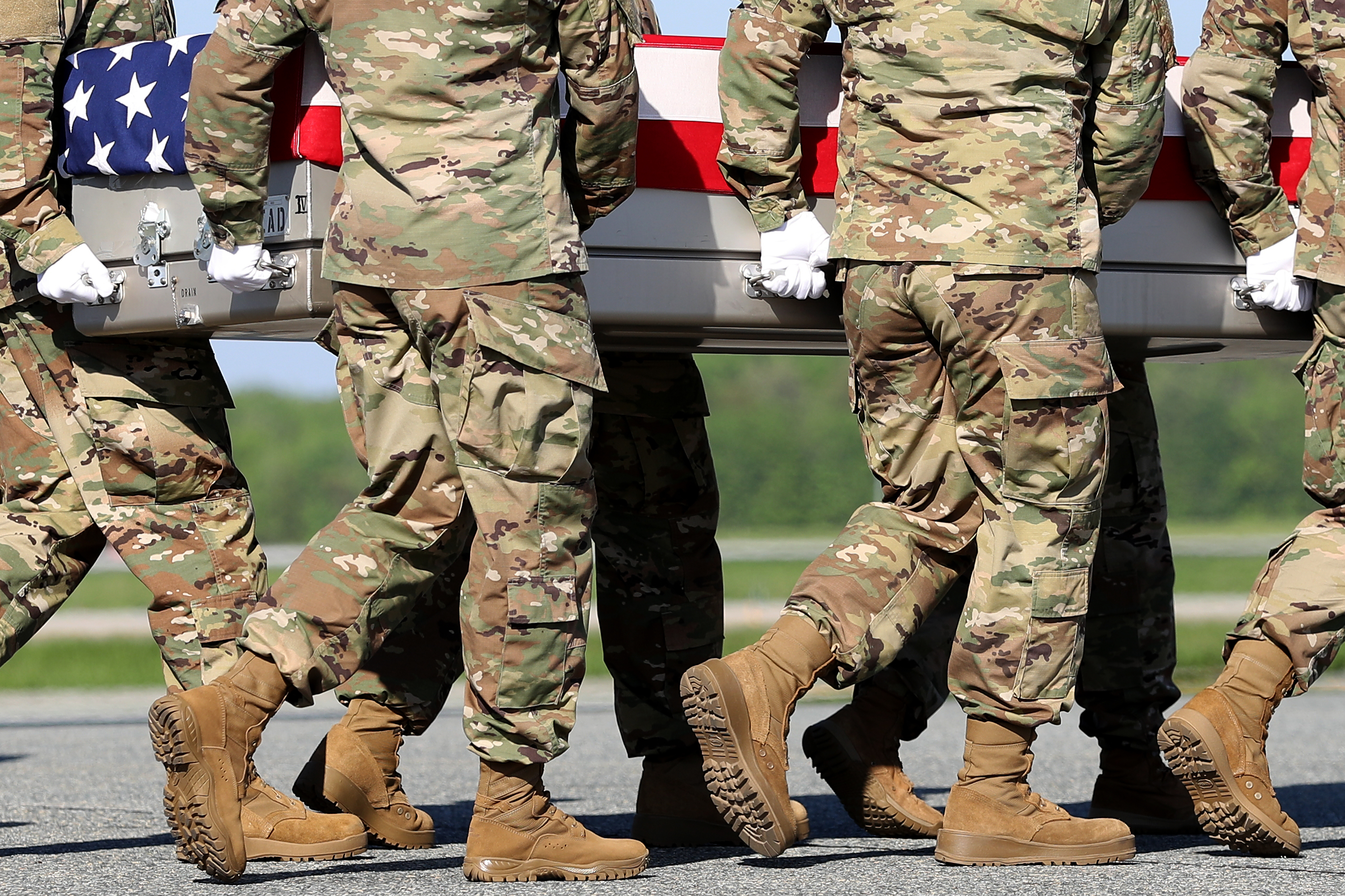 U.S. Army soldiers carry the flag-draped transfer case containing the remains of U.S. Army Ranger Sgt. Cameron H. Thomas at Dover Air Force Base. (Getty Images)