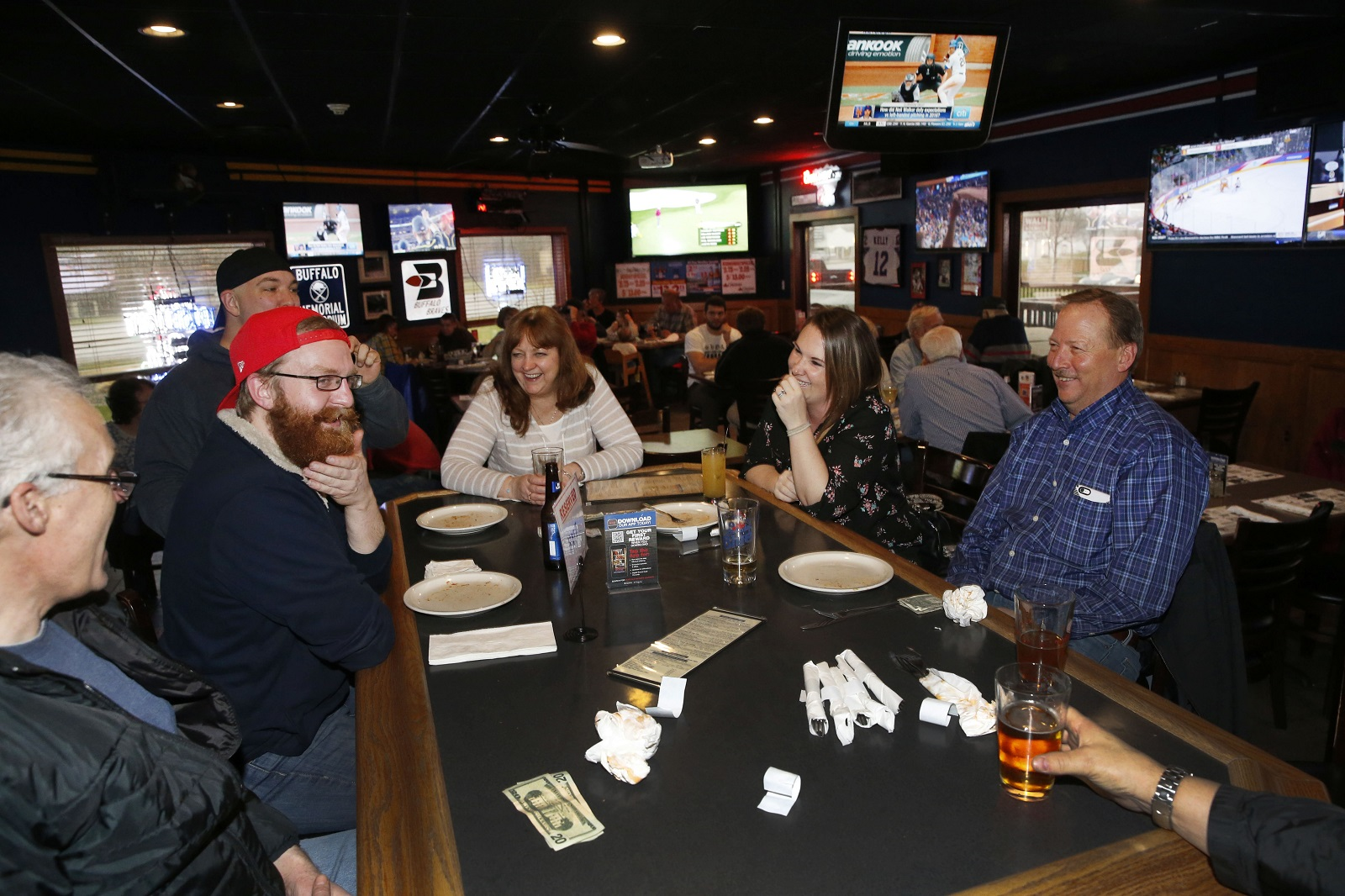 Brian Freeburg, C.J. Massett, Branden Bonk, Margaret Potter, Kerrie Bonk and Pete Whitehead gather for dinner at Buffalo Sports Garden. (Sharon Cantillon/Buffalo News)