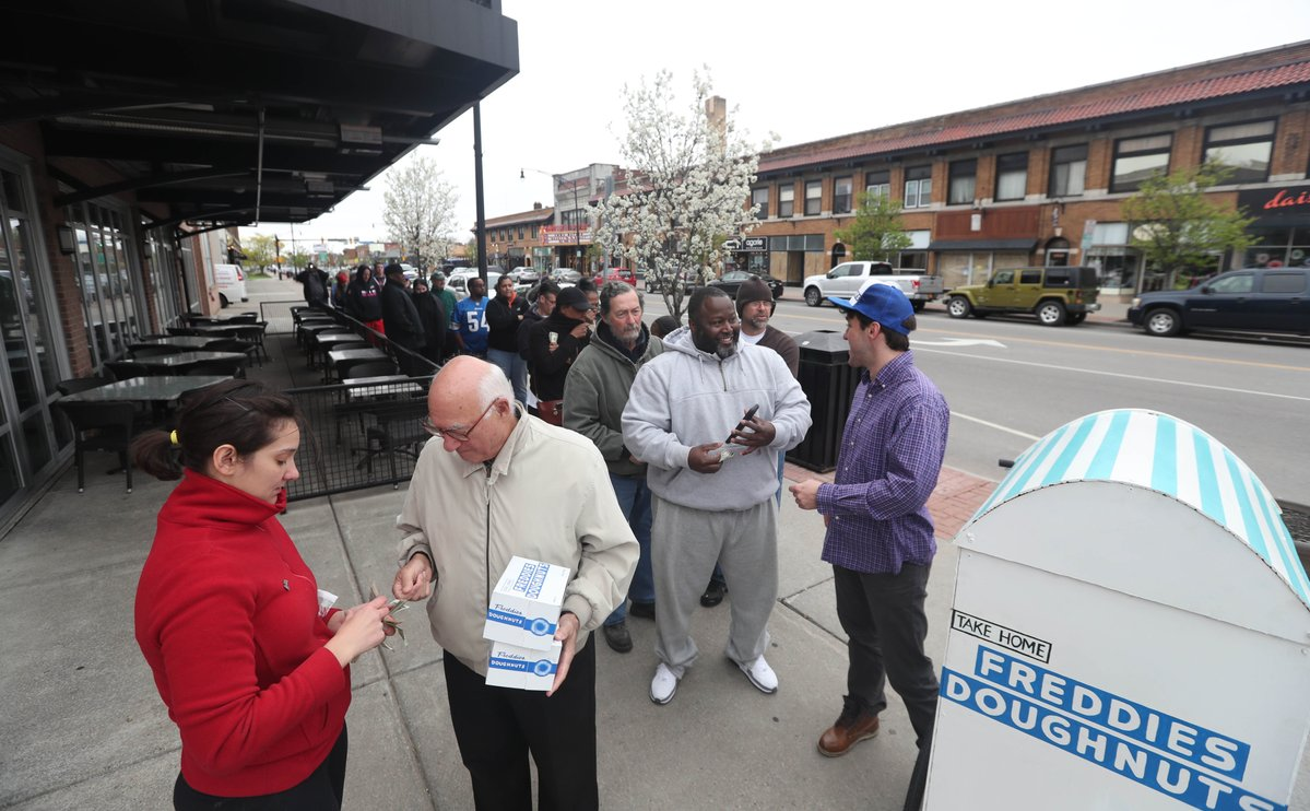 People lined up Saturday for Freddies Doughnuts on Hertel Avenue, which sold out by 9:45 a.m. (Sharon Cantillon/Buffalo News)