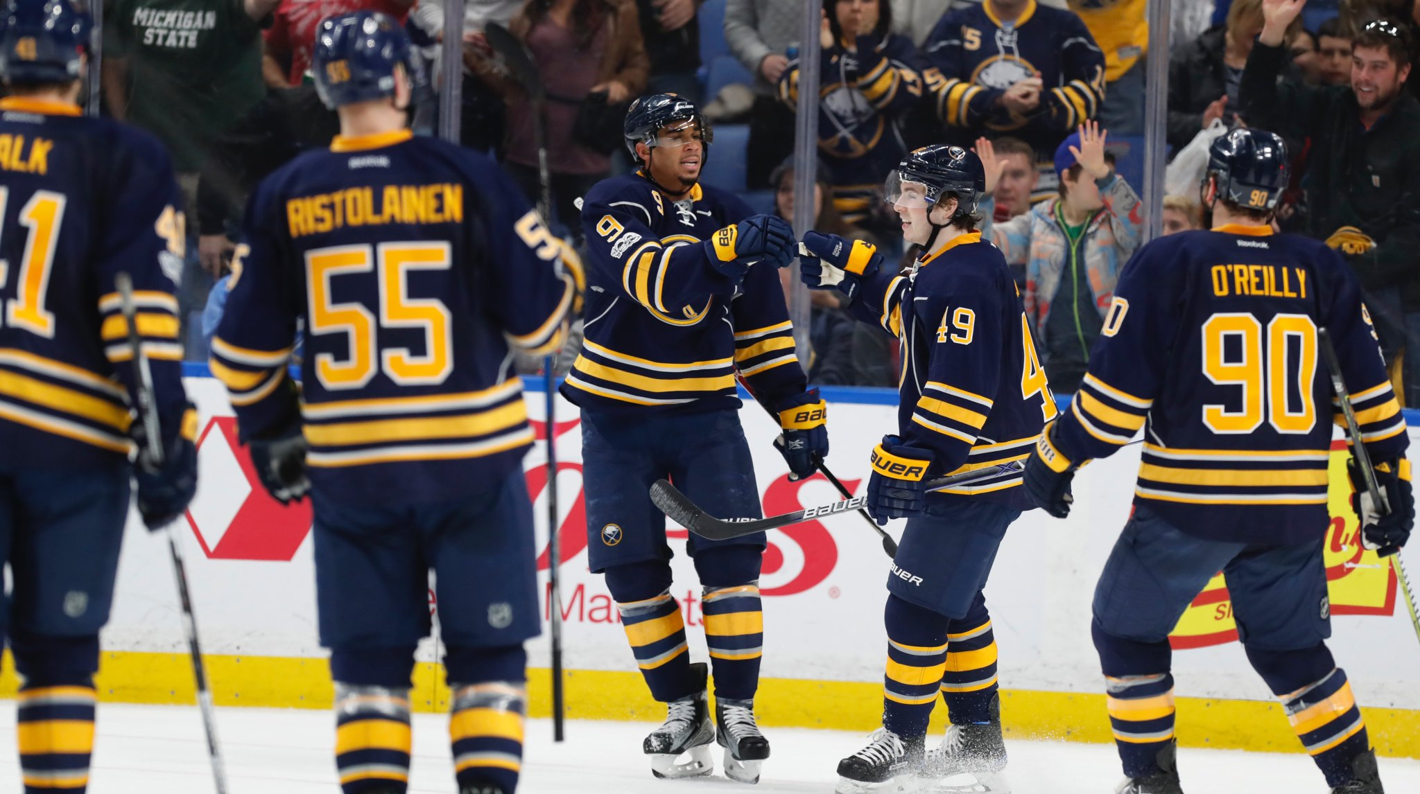 Goal-scorer Evander Kane (9) congratulates C.J. Smith on the assist and his first point in Smith's NHL debut Sunday. (Harry Scull Jr./Buffalo News)